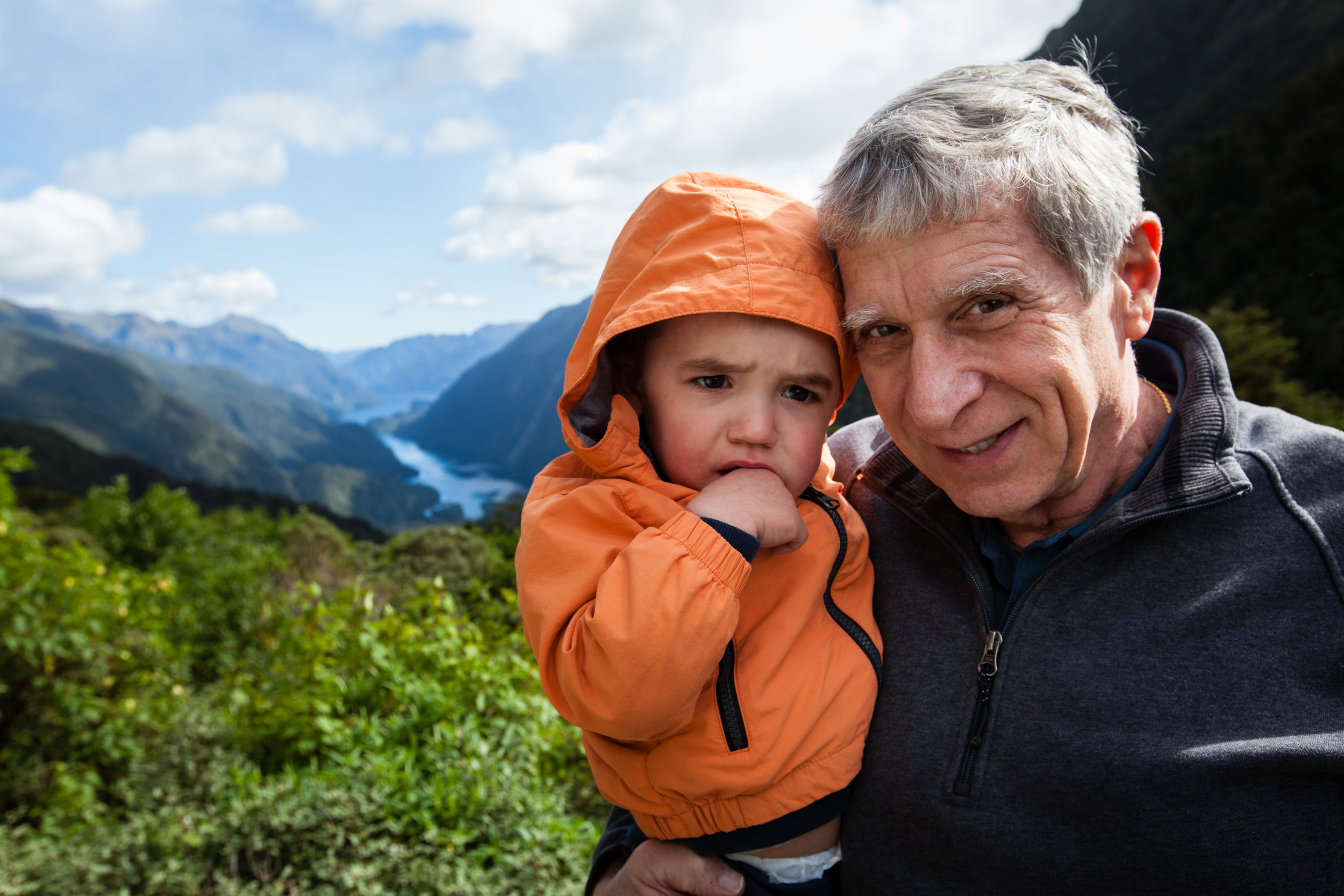 Checking out the view of Doubtful Sound with Grandpa. No smiles here, but still having a good time!
