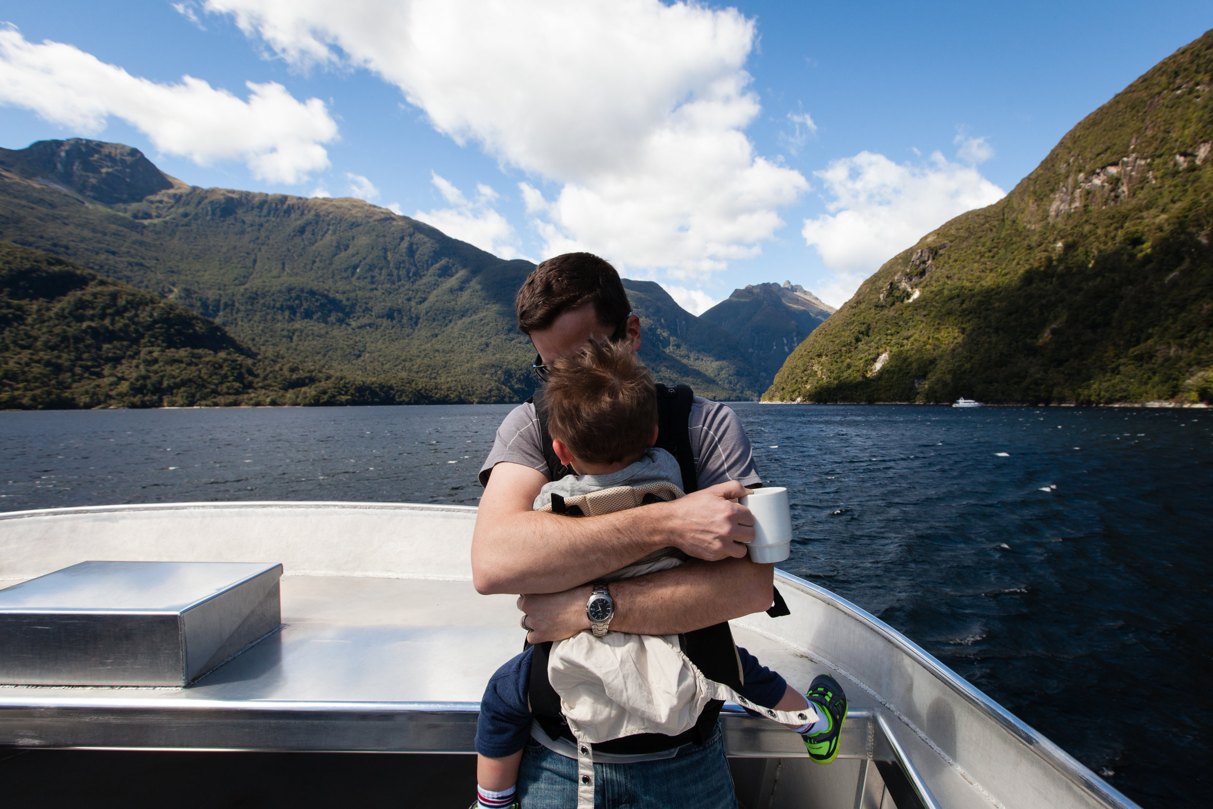 Attempting nap time with Daddy on the boat. It failed. Fell asleep on the bus ride back over the pass to Manapouri. Late nap but still worked out.