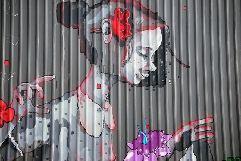 mural girl nike mexico flowers