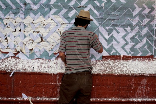 Artist painting mural in Mexico City