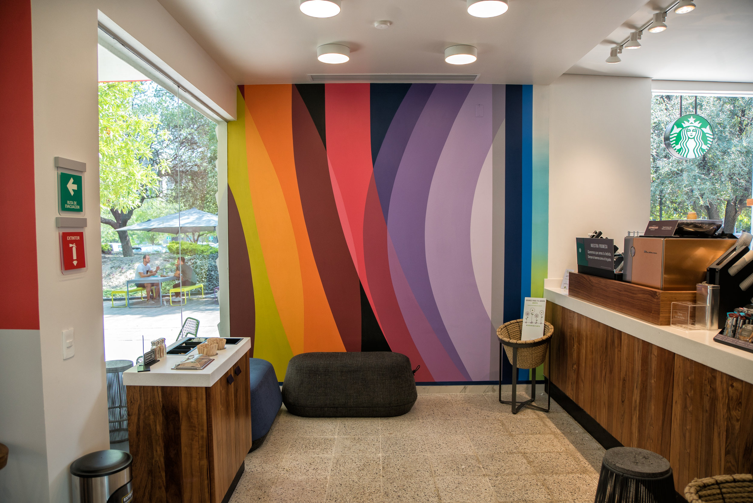 Colorful abstract mural art inside bank at University in Monterrey