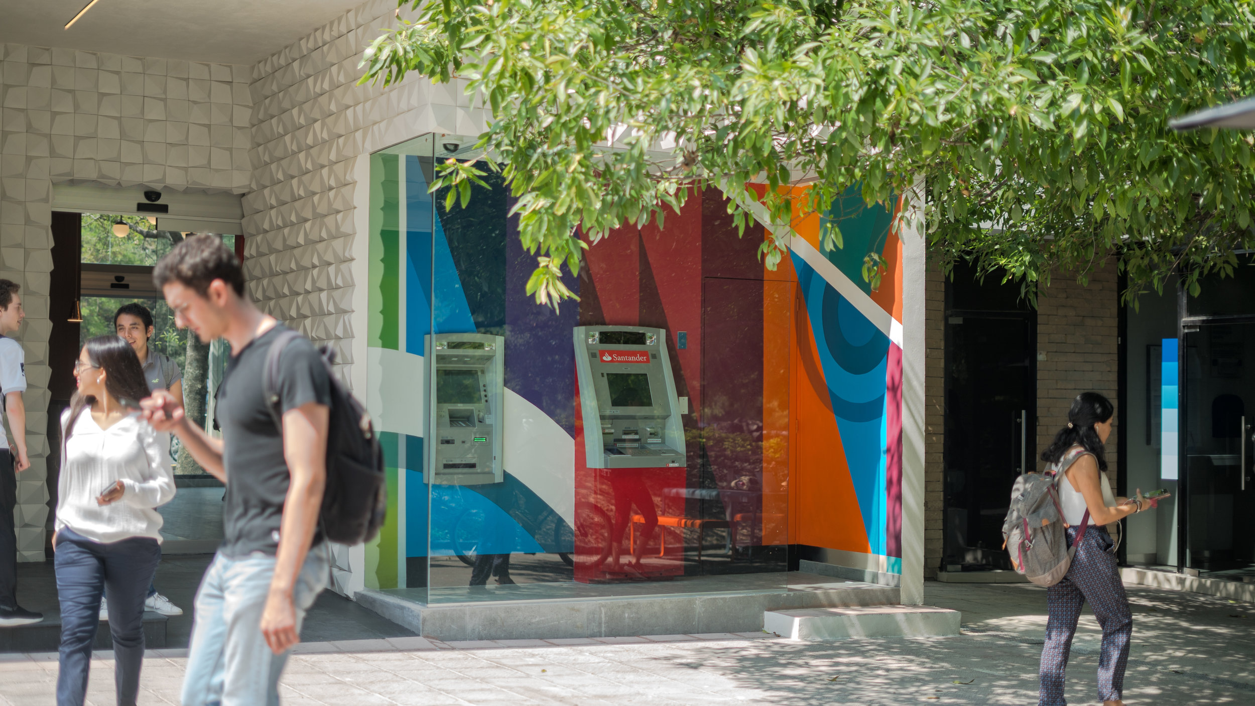 Mural art inside ATMs area of bank branch at university