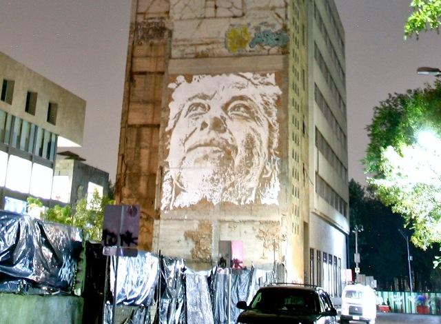 Street art on the side of the building artist Vhils