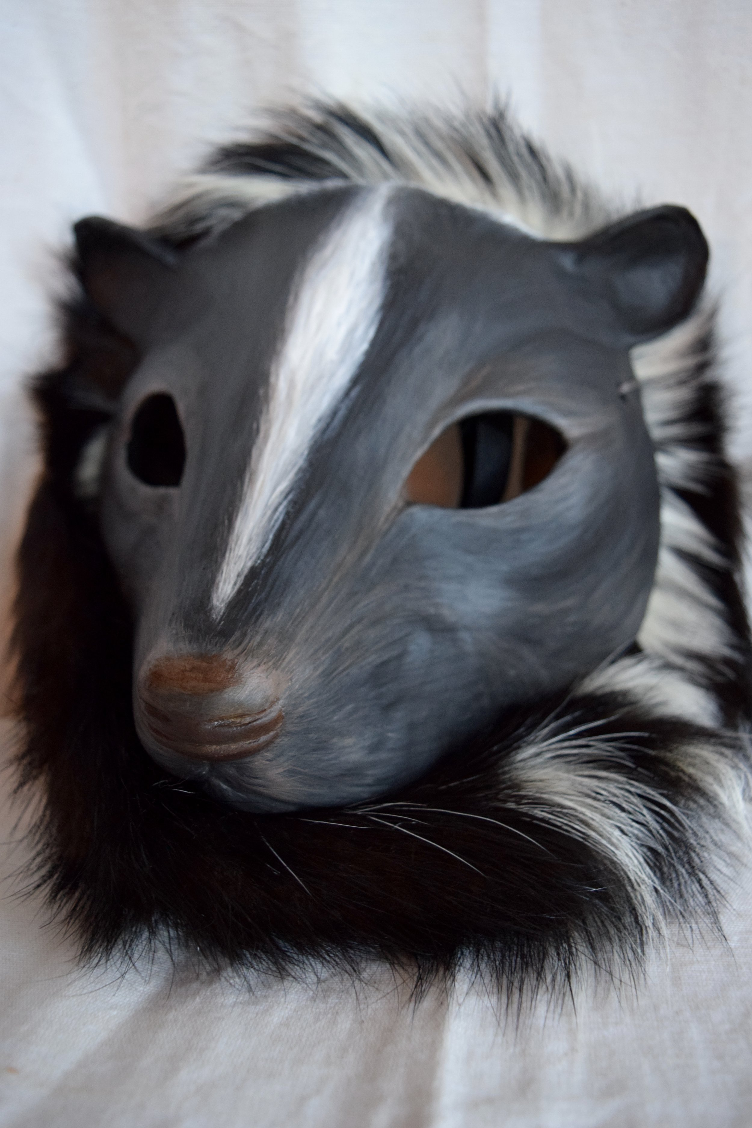 Skunk, 2015. Clay, roadkill skunk hide, acrylic  Sold