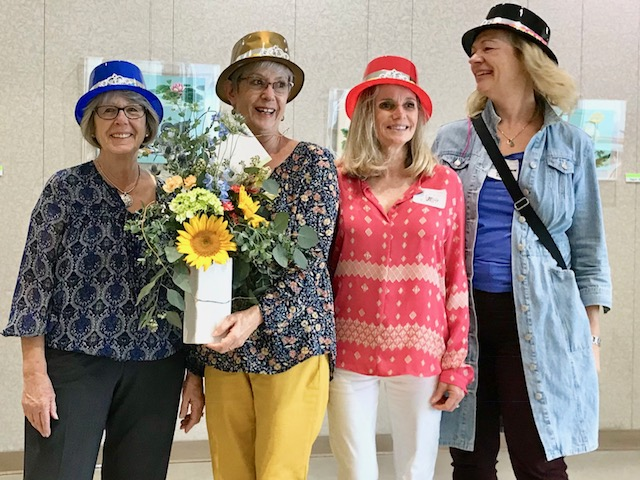 Linda Faulkner, Gretchen Hiegel, Janis Reeser, and Barbara Ruys at the November, 2017 potluck and volunteer appreciation. Hats off to the Board!