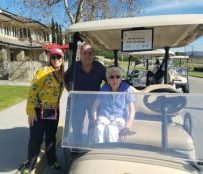 Dorothy in her golf cart and ready to go with son, Fred and Director Ashley Cole.