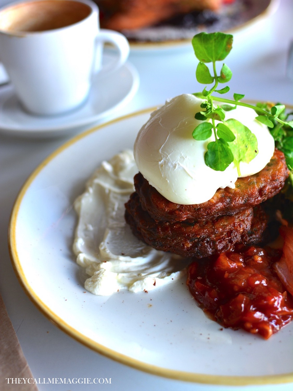 St Zita's fritters - sweet corn, zucchini and mint fritters, with creme fraiche, watercress, two poached eggs, black bean feta and avocado smash