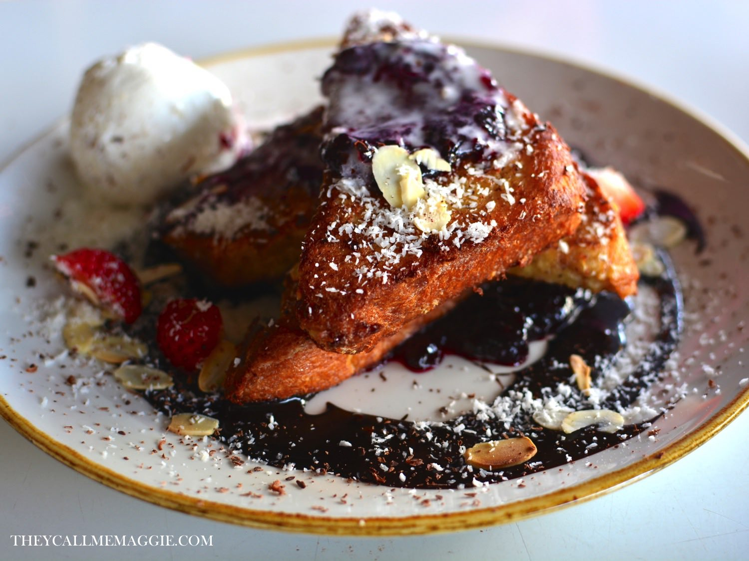 Black forest french toast - with Morello cherry jam, chocolate cacao sauce, toasted almond flakes and coconut ice cream