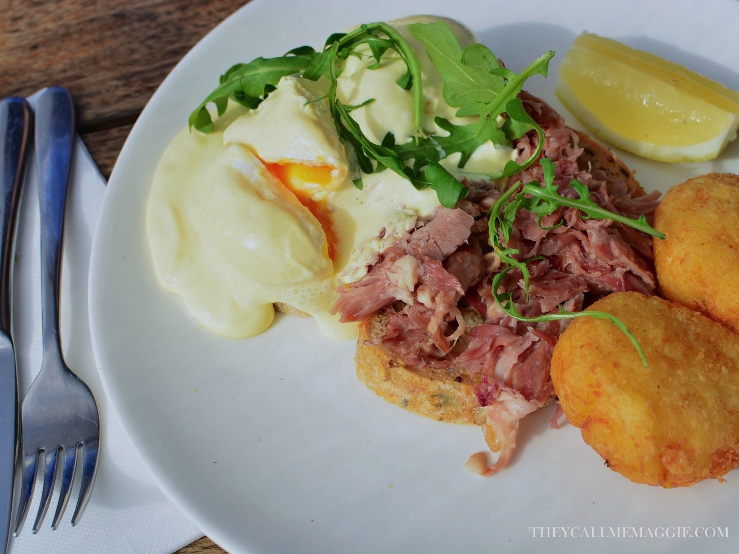 Eggs benedict with pulled ham hock, poached eggs, apple cider hollandaise and potato hash.