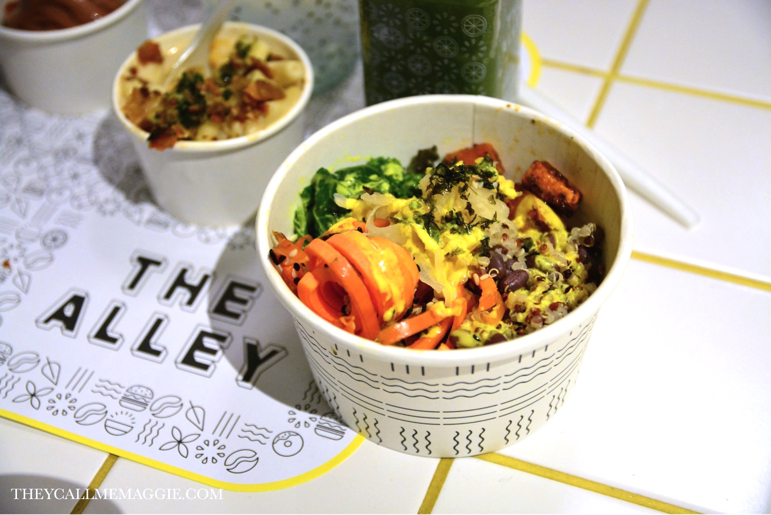 The Alley Signature Macro Bowl - quinoa medley with sauteed kale, roast sweet potato, adzuki beans, carrot ribbons, sesame seeds, crunchy nori flakes, pickled vegetables and a tumeric tahini dressing.