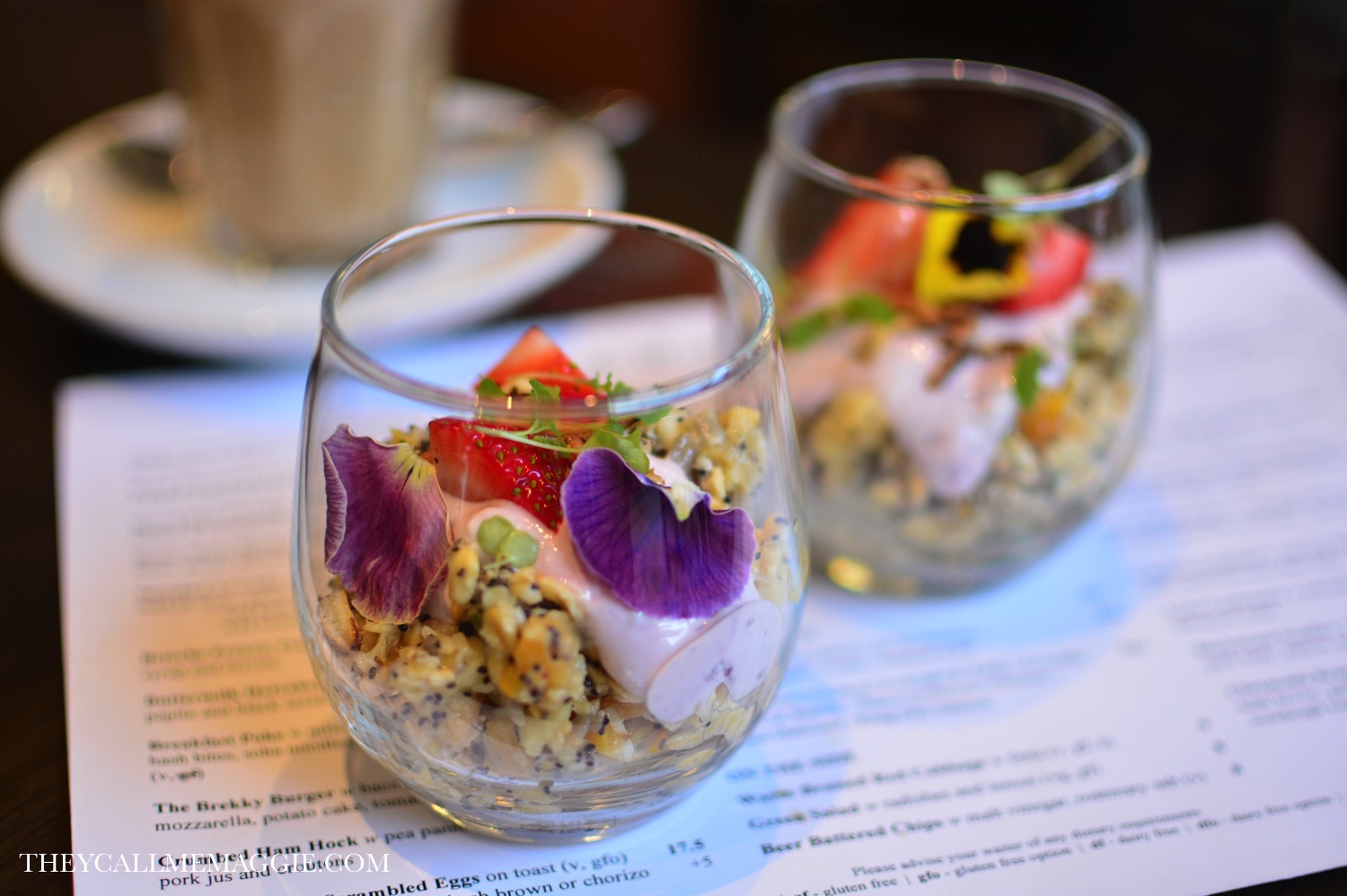House made bircher muesli with poached autumn fruits, grains, berried yoghurt and chai crisp.