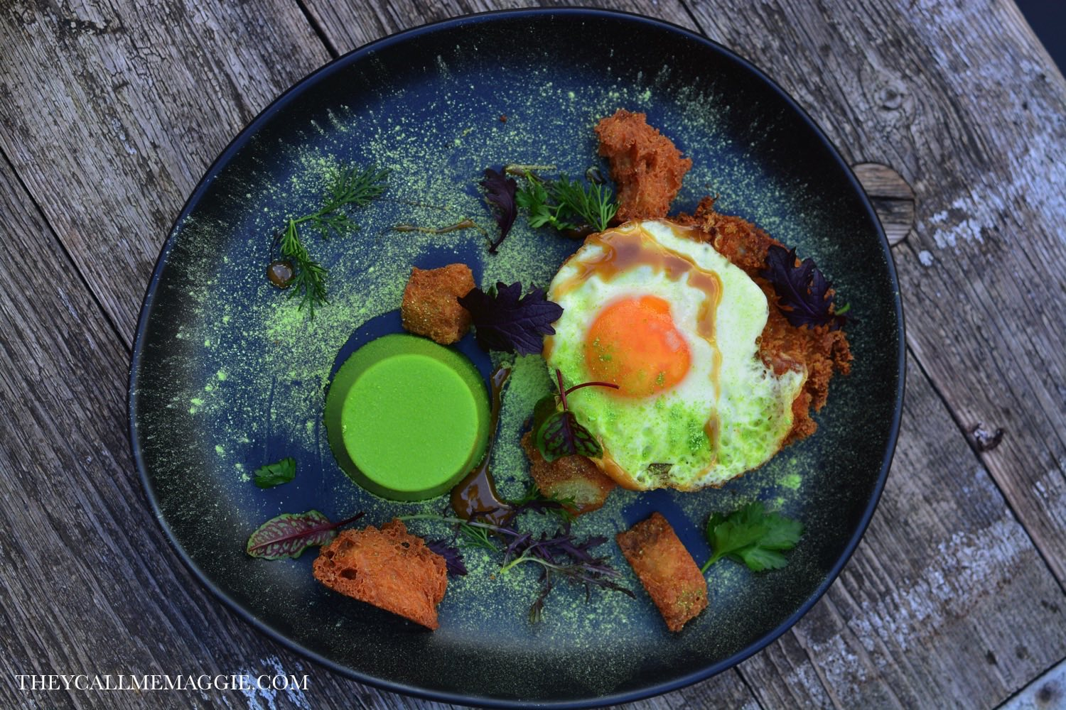 Crumbed ham hock with pea panna cotta, fried egg, pork jus and croutons.