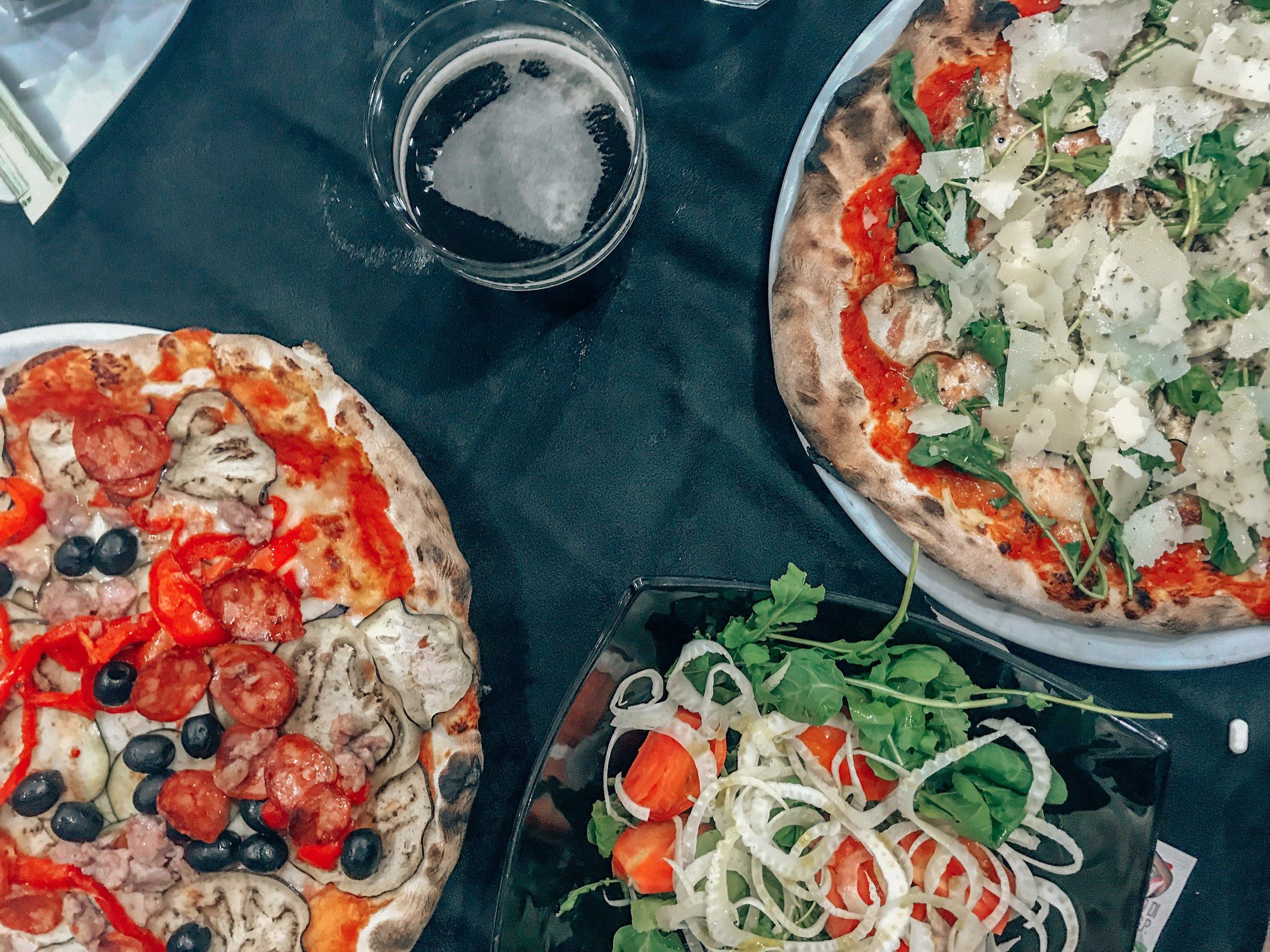 dining on pizza in Sardinia
