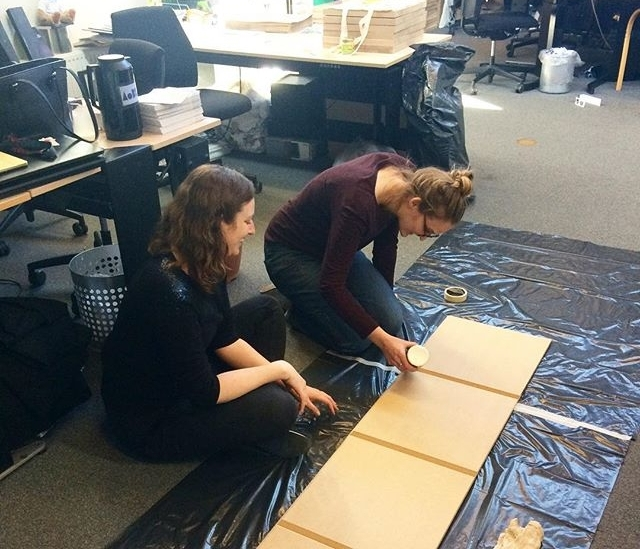 Sasha and Pam building a plinth in the office.
