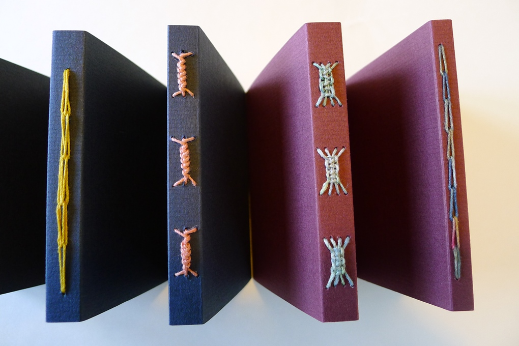 soft cover stitched books with varying numbers of signatures inside