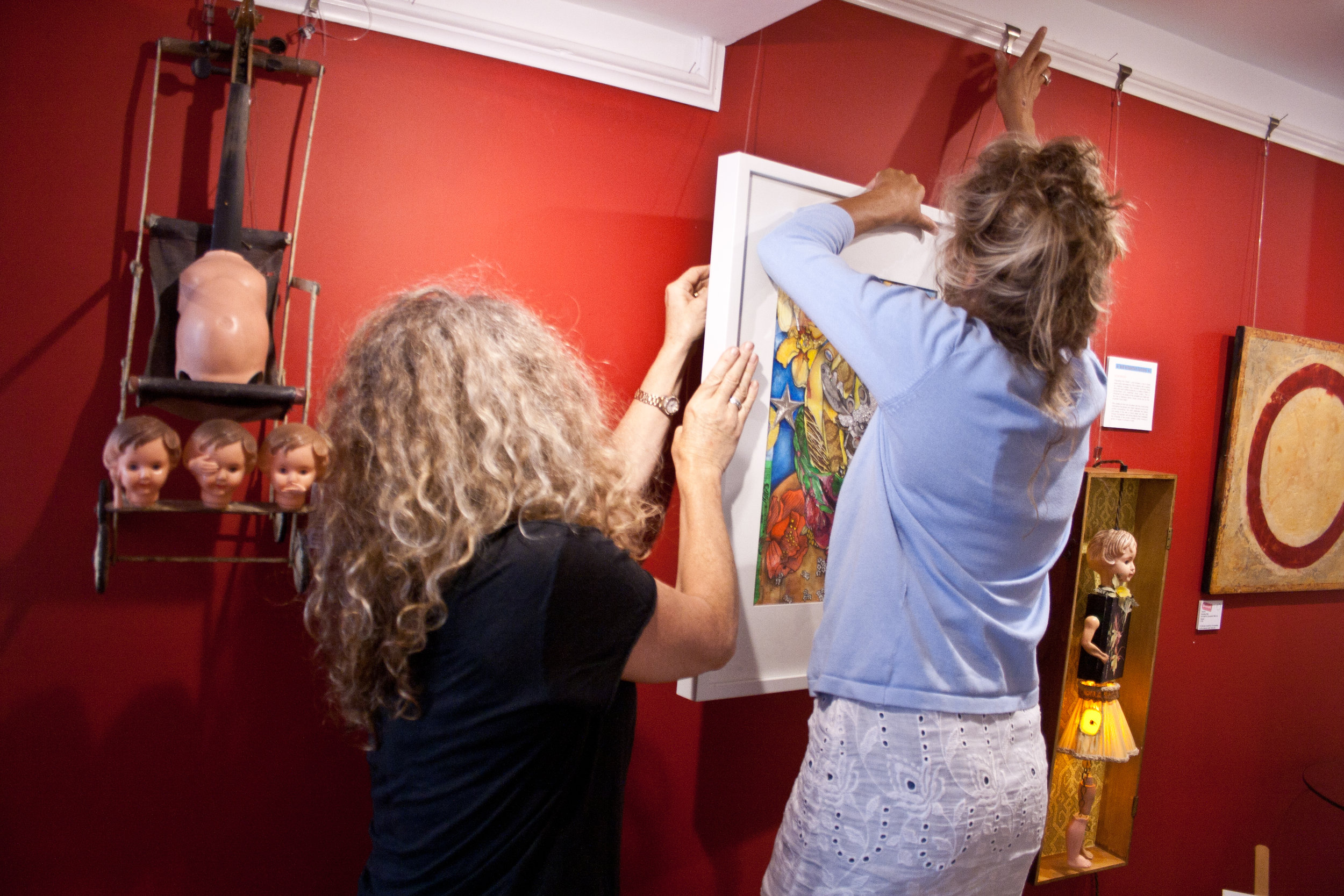 - Always busy curating our gallery space - Sarah & Sallyann work together to keep Red Propeller looking fabulous!