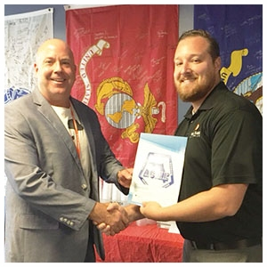 Aaron Hall, Florida ACME Secretary, presenting a scholarship to MSG Randy Schummer, USA, Ret., 2016 Veteran Recipient