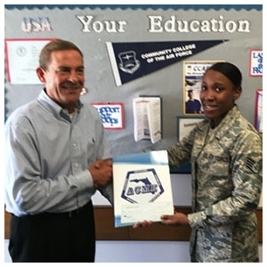 Keith Davis, Florida ACME Vice President, presenting a scholarship to SSgt Alicia Hunt, 2016 Active Duty recipient.