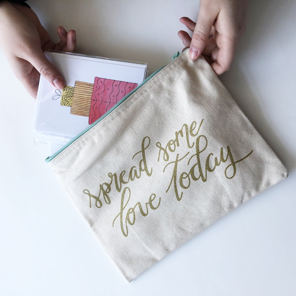 An example of a bundle with the canvas pouch/bag, 10 random greeting cards, and a pen.