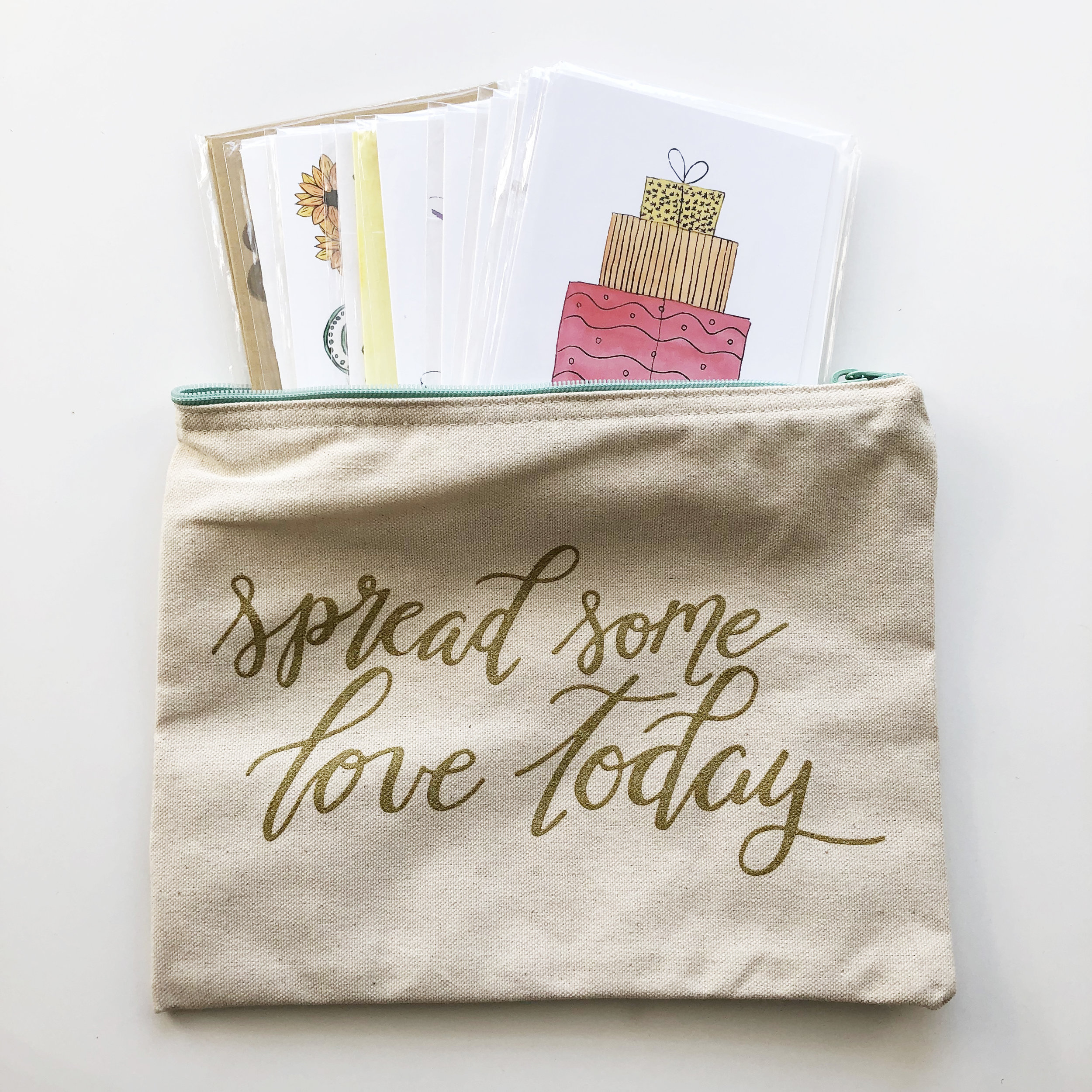 Zippered Canvas Bag + Greeting Cards Bundle    Your mom will enjoy this bundle! In the bundle she will get 10 random greeting cards, a pen, and the zippered bag to hold all of her letter writing supplies.  $22