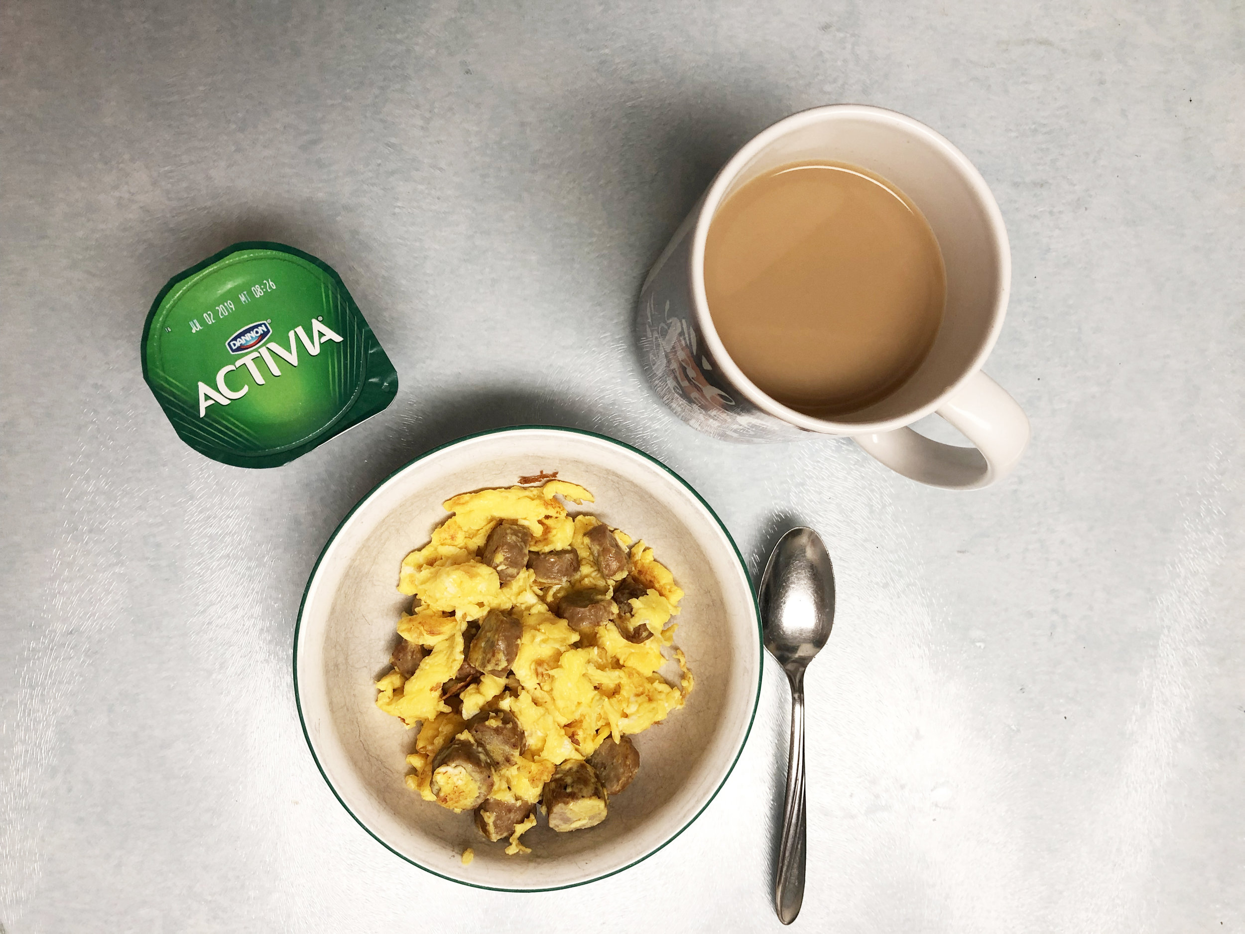 The eggs, Activia yogurt and coffee I have for breakfast.