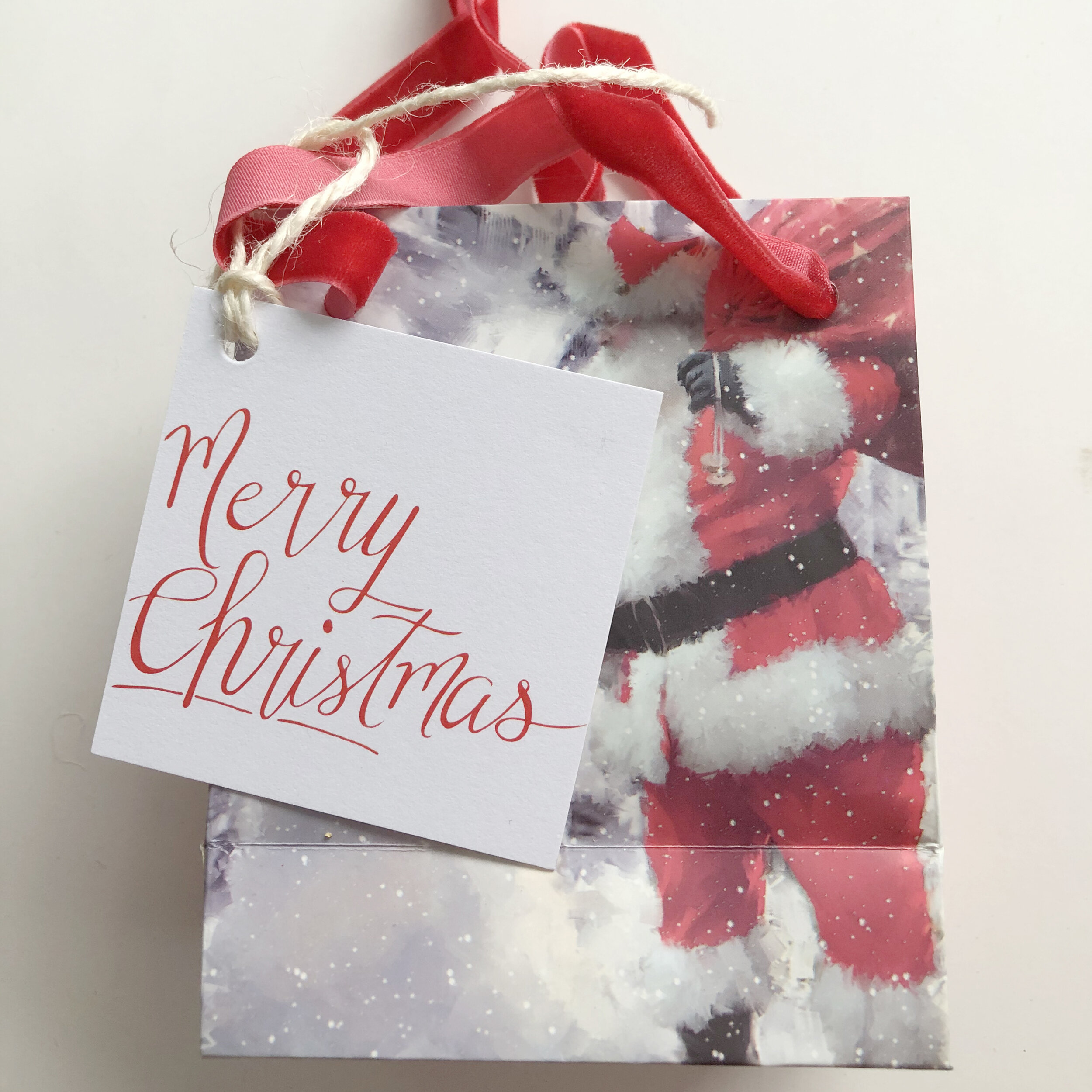 This  gift tag design  was a hit last year. Now it's in a square format.