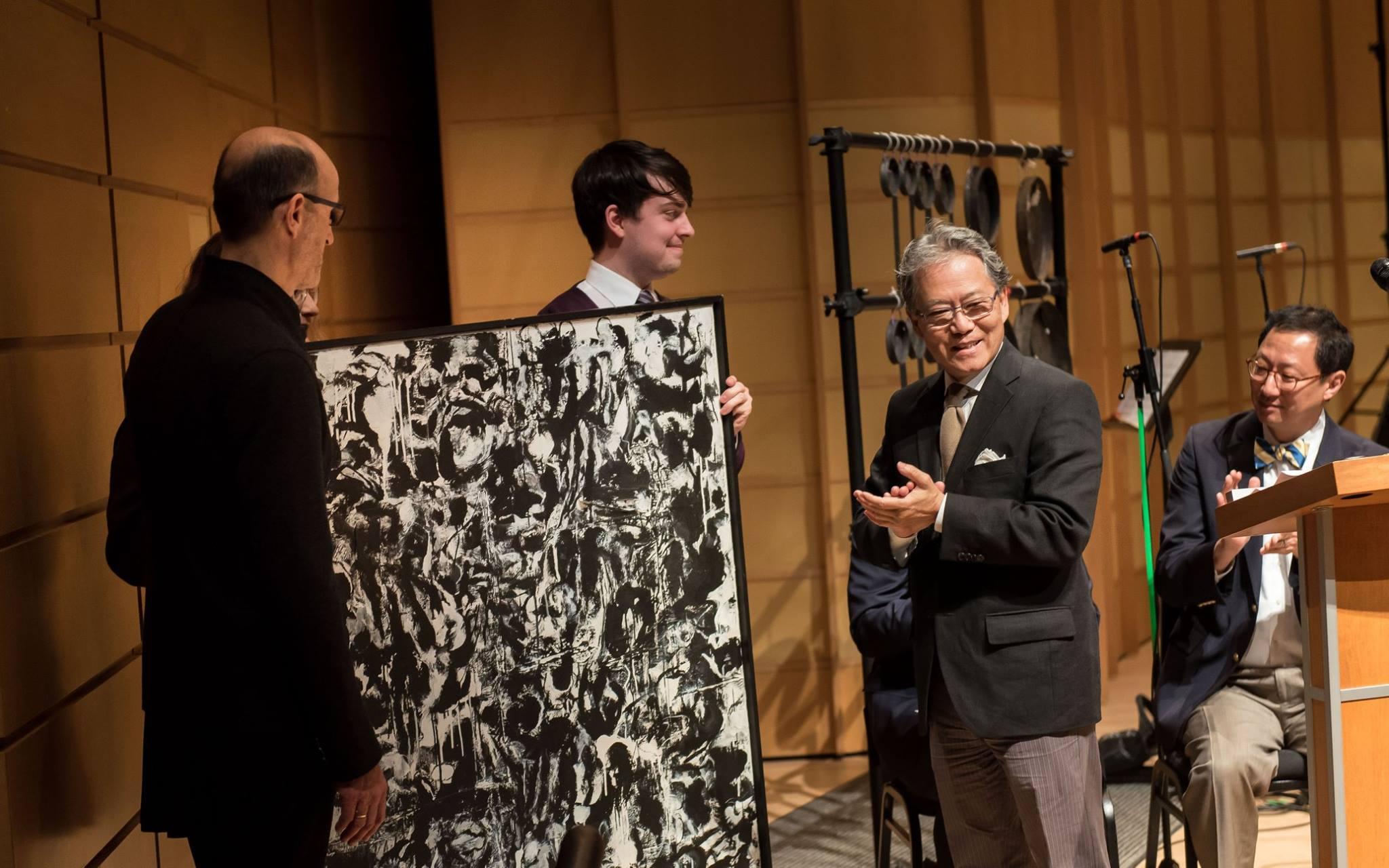 Bing Thom Associates presents a gift to Tom Chan. Photo: Paul Joseph/UBC
