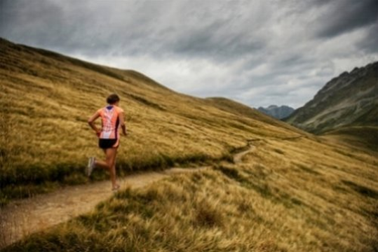 Woman Trail Running in the Mountains | Baboon Outdoors