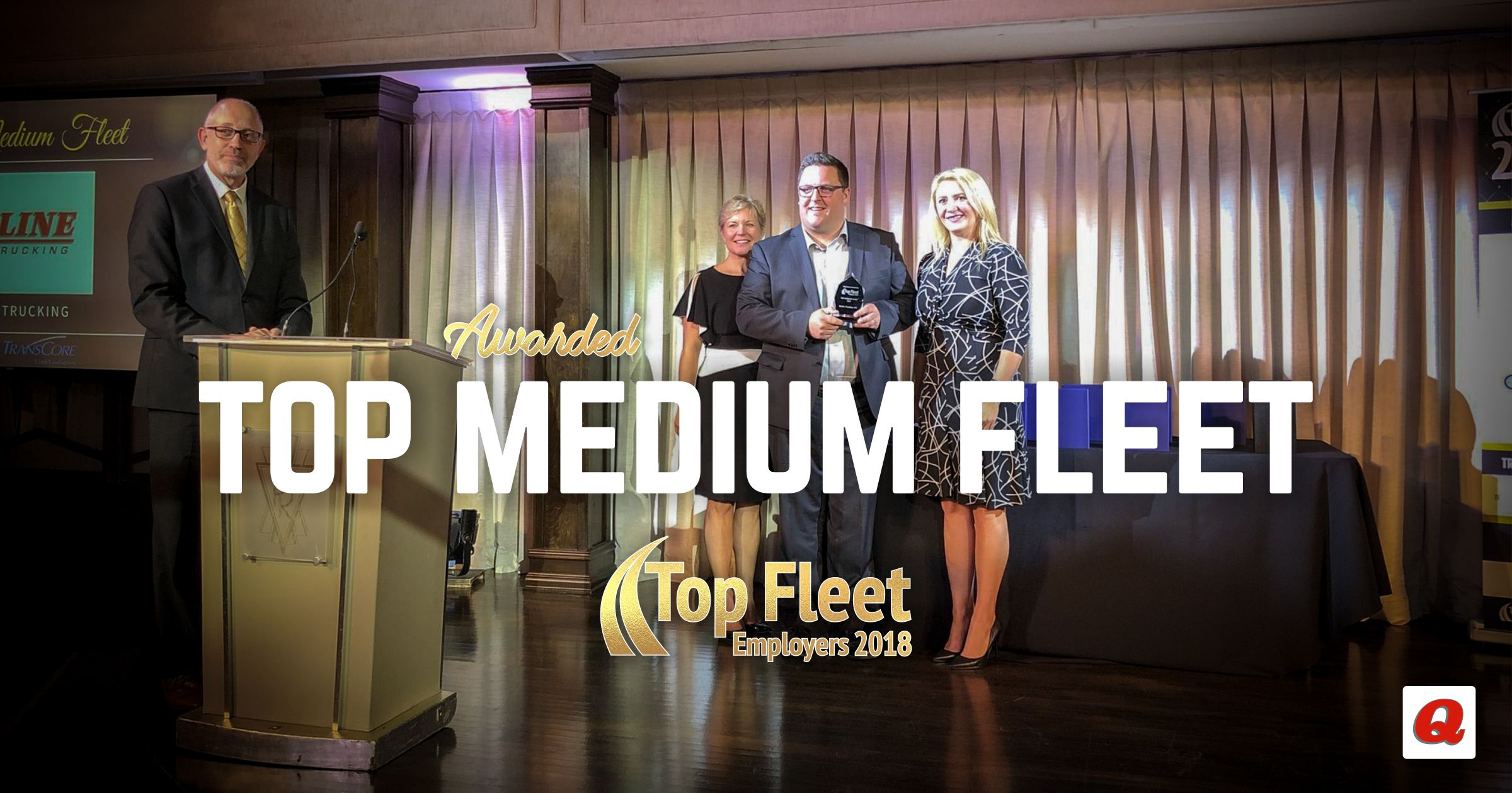 Q-Line Trucking's HR Manager, Eddy Nesdoly, accepts the award for Top Medium Fleet!