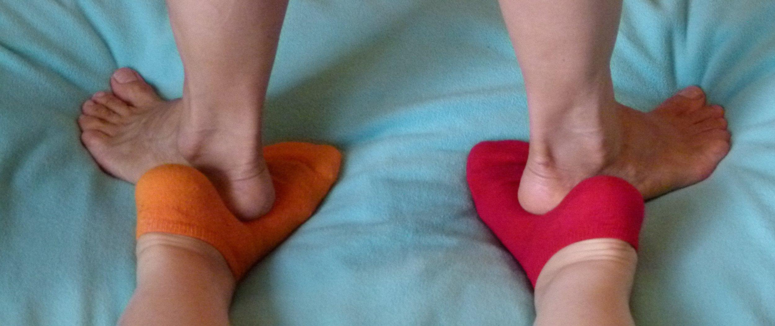 massaging feet with feet