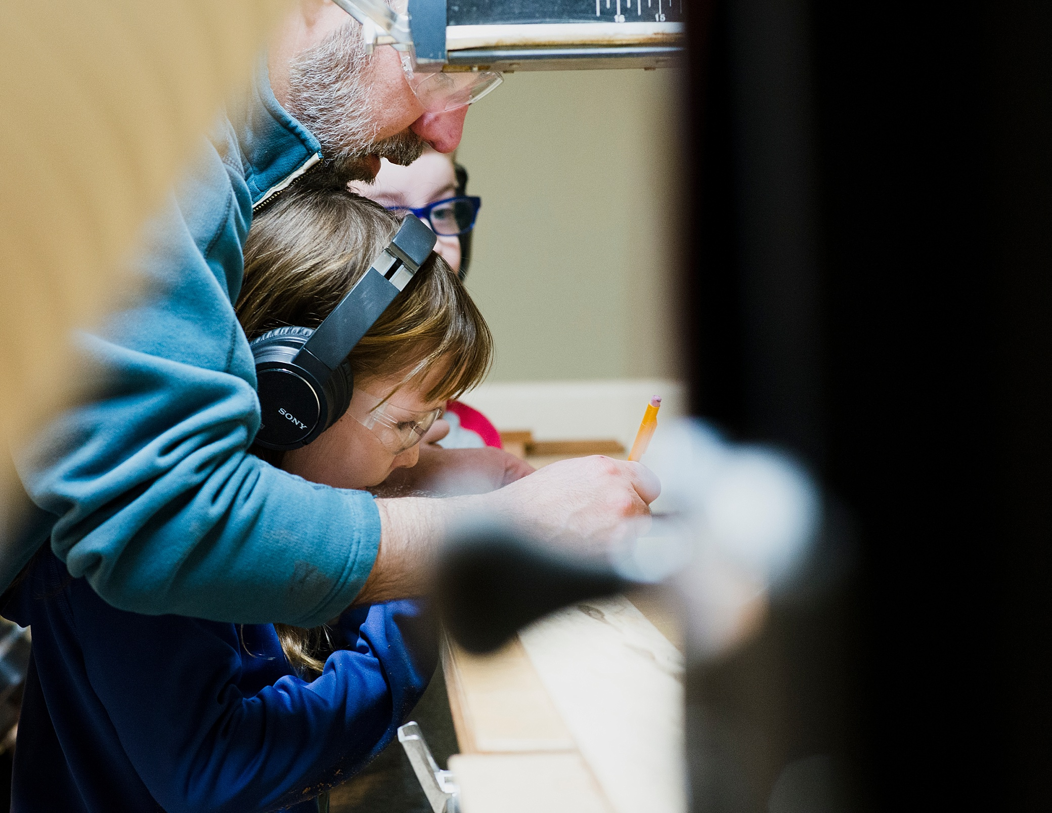 denver family photographer girl helping in woodshop