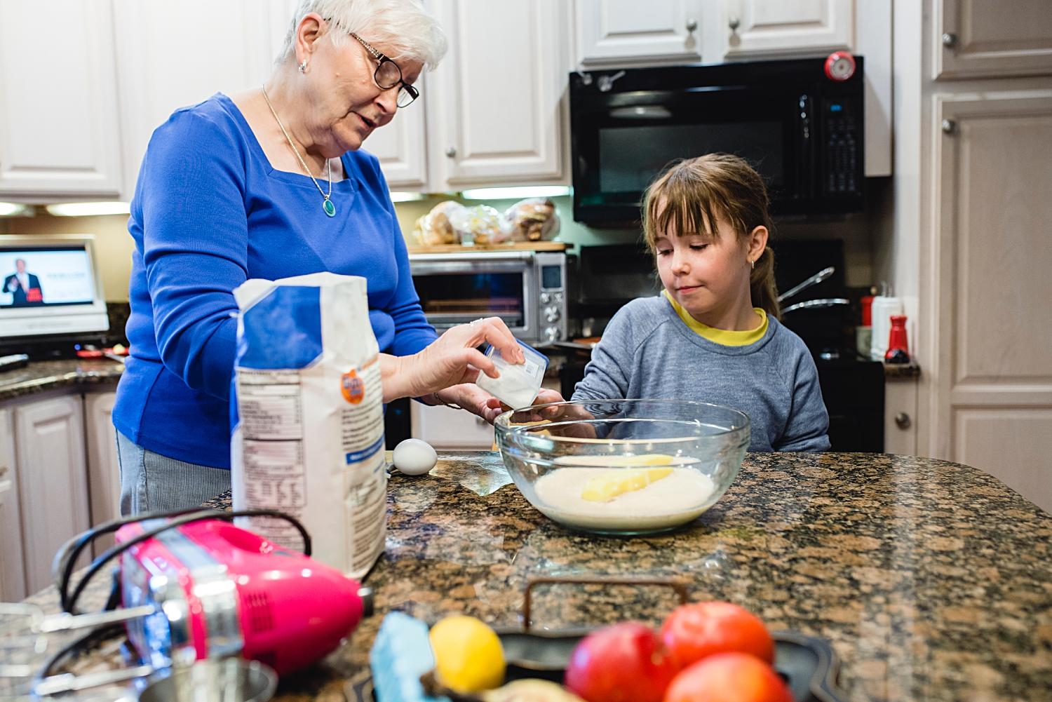 Mom teaching my daughter to make Finnish pulla bread while we were on vacation. Photos by Denver Family Photographer, Kristiina Craven.