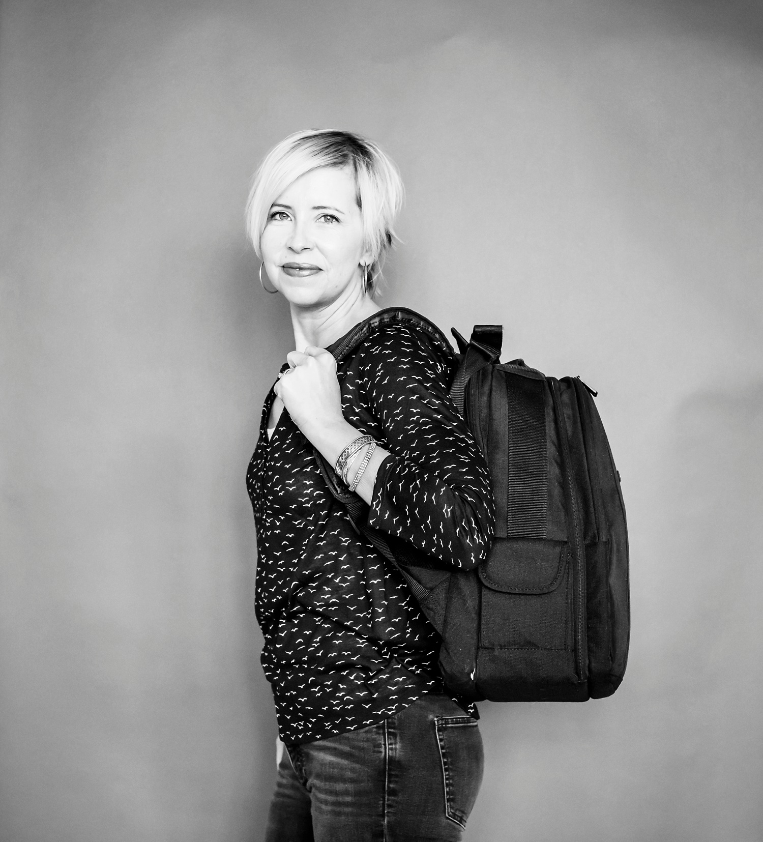 Top 5 things to carry in your camera bag: A woman models the Amazon Basics DSLR and Laptop Backpack. | Denver Family Photographer