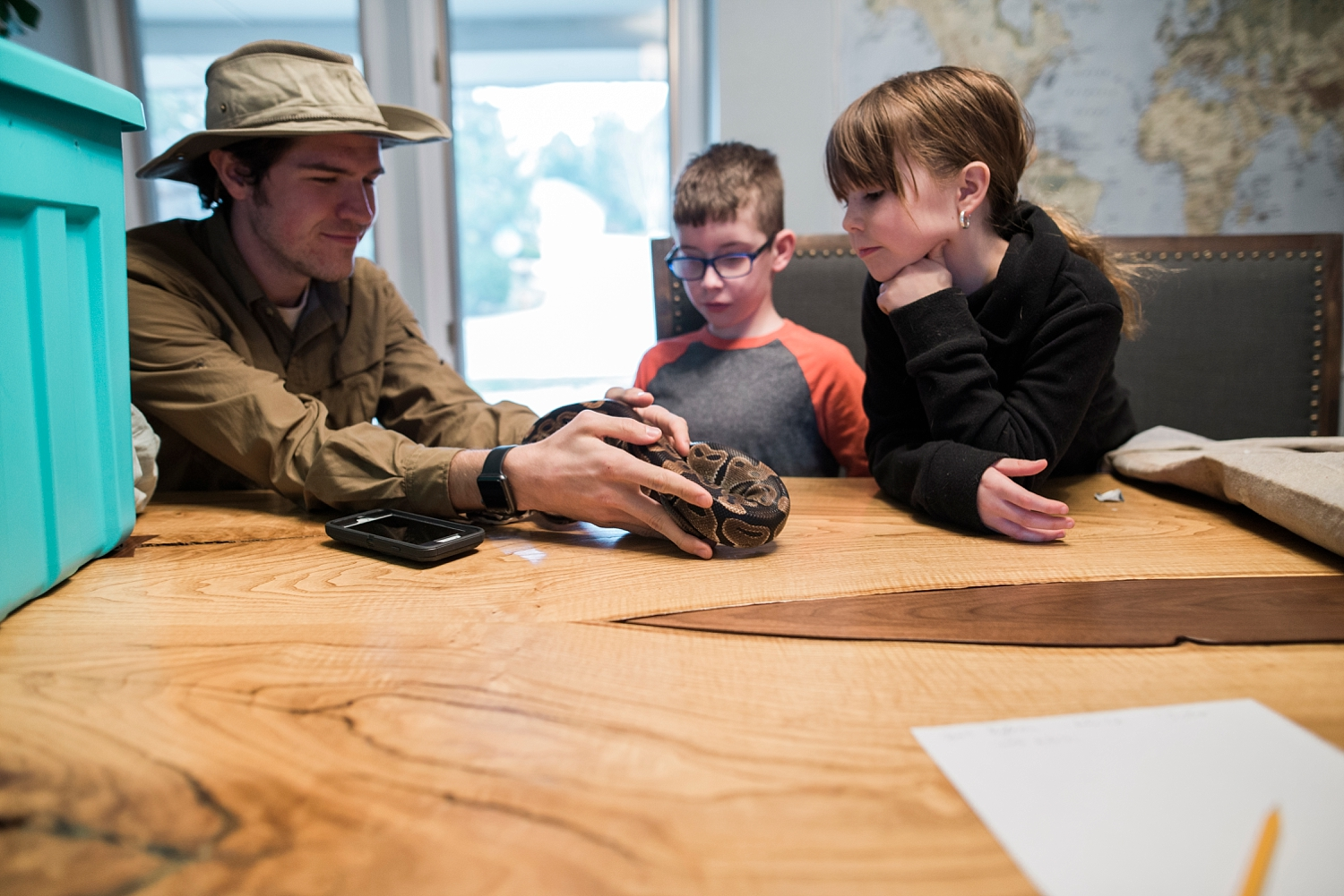 kids-hold-snake-during-in-home-reptile-class-denver-getting-unschooled.jpg
