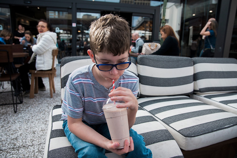 When traveling, sometimes a milkshake counts for a meal. #improvise | GettingUnschooled.com | #homeschooltravel #autism #roadschool