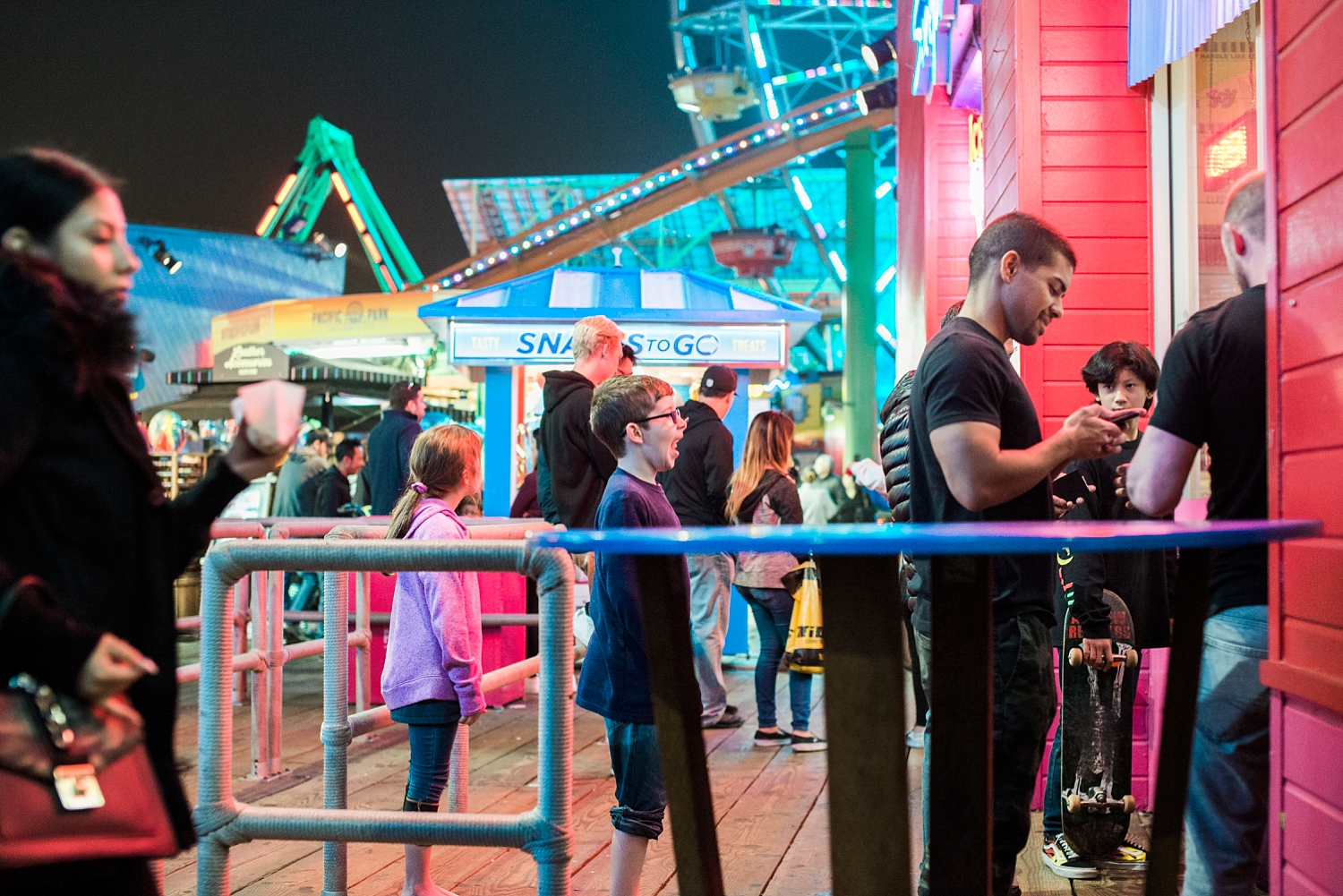 Tired kids, but not too tired to wait in line for dippin' dots at the Santa Monica Pier on our first roadschool trip together. | GettingUnschooled.com | #roadschooling #homeschooltravel #unschooling