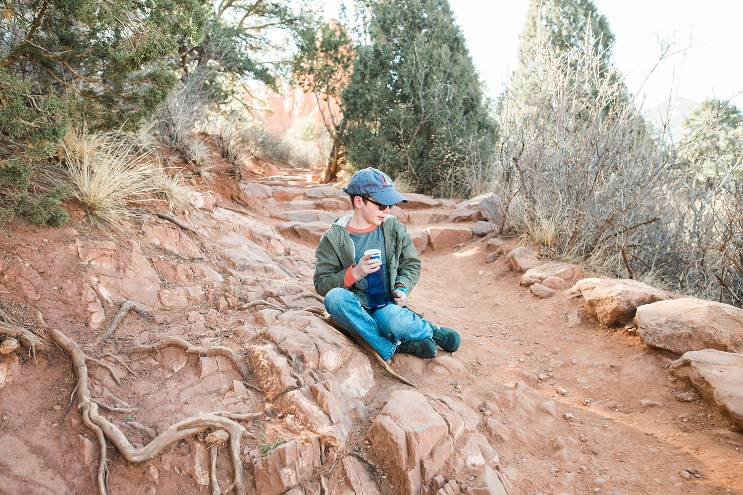 Townes takes a water break while hiking at the Garden of the Gods in Colorado Springs, Co. | GettingUnschooled.com | #unschooling #homeschooladventure #coloradodaytrip