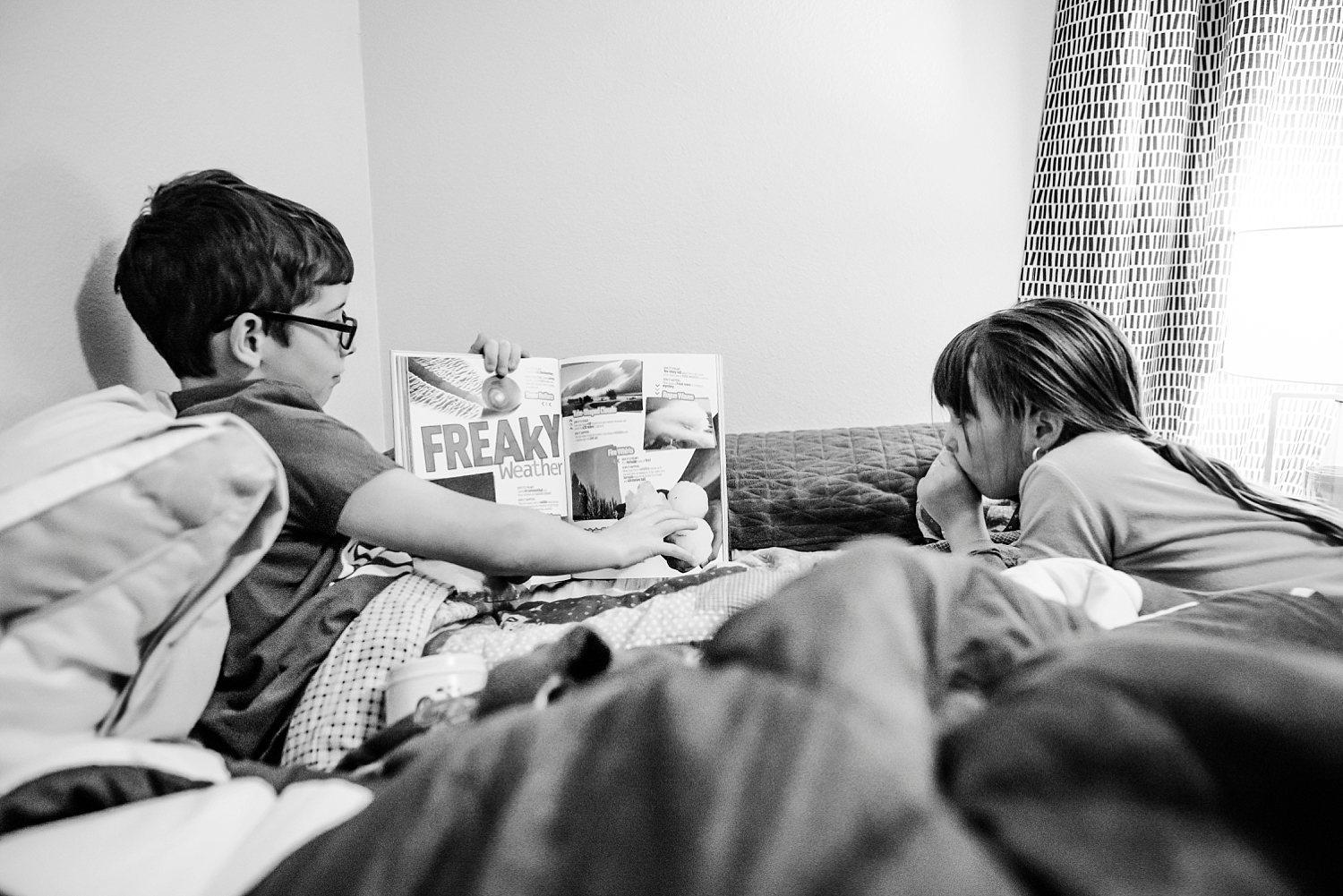 Townes points out something freaky from his book before bed. | GettingUnschooled.com