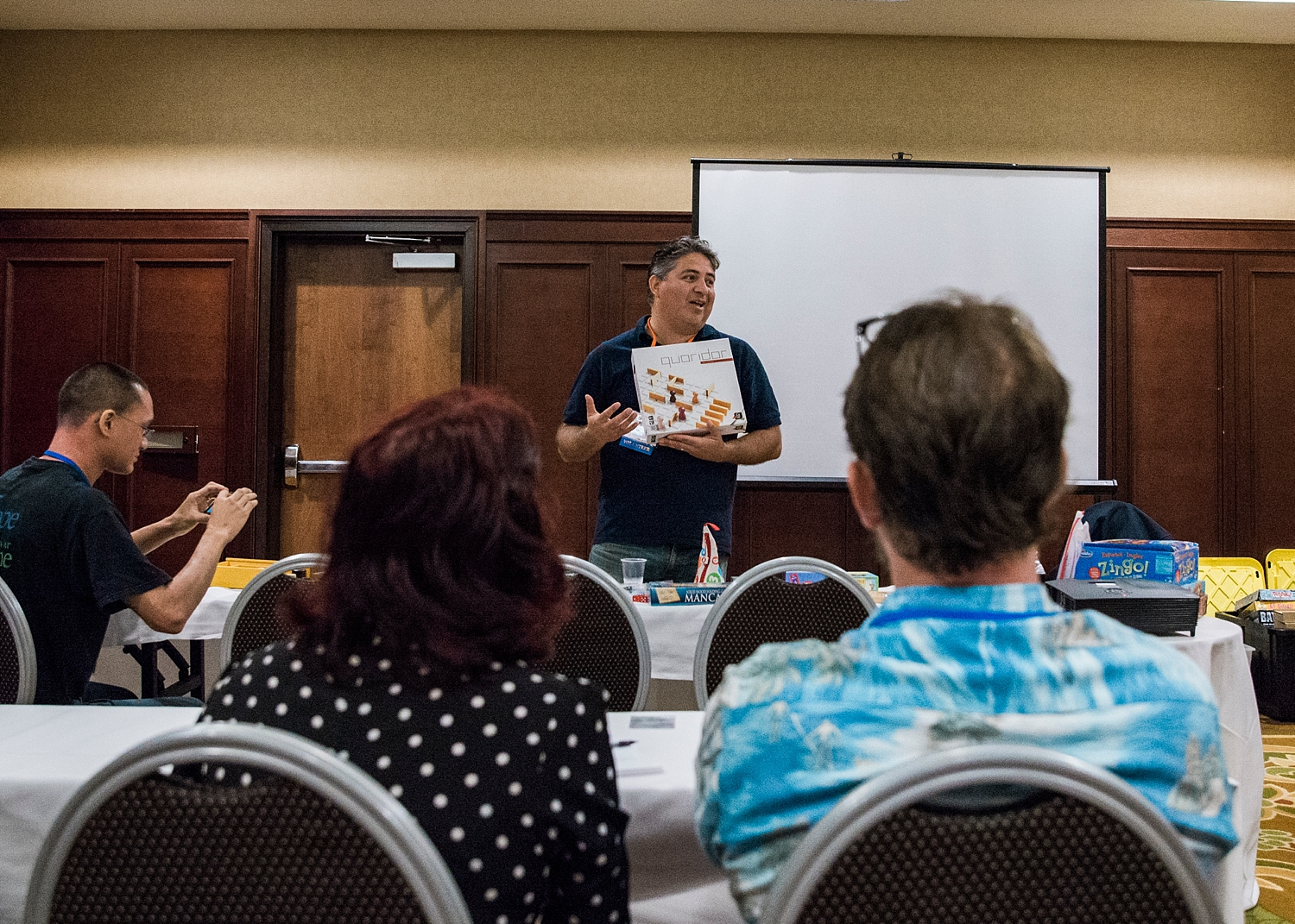 Carlos Angeles gives a high-energy talk on how kids learn through playing games at the HSC DiscoveryCon in Anaheim, California. | GettingUnschooled.com | #unschooling #homeschool #roadschool #mathgames
