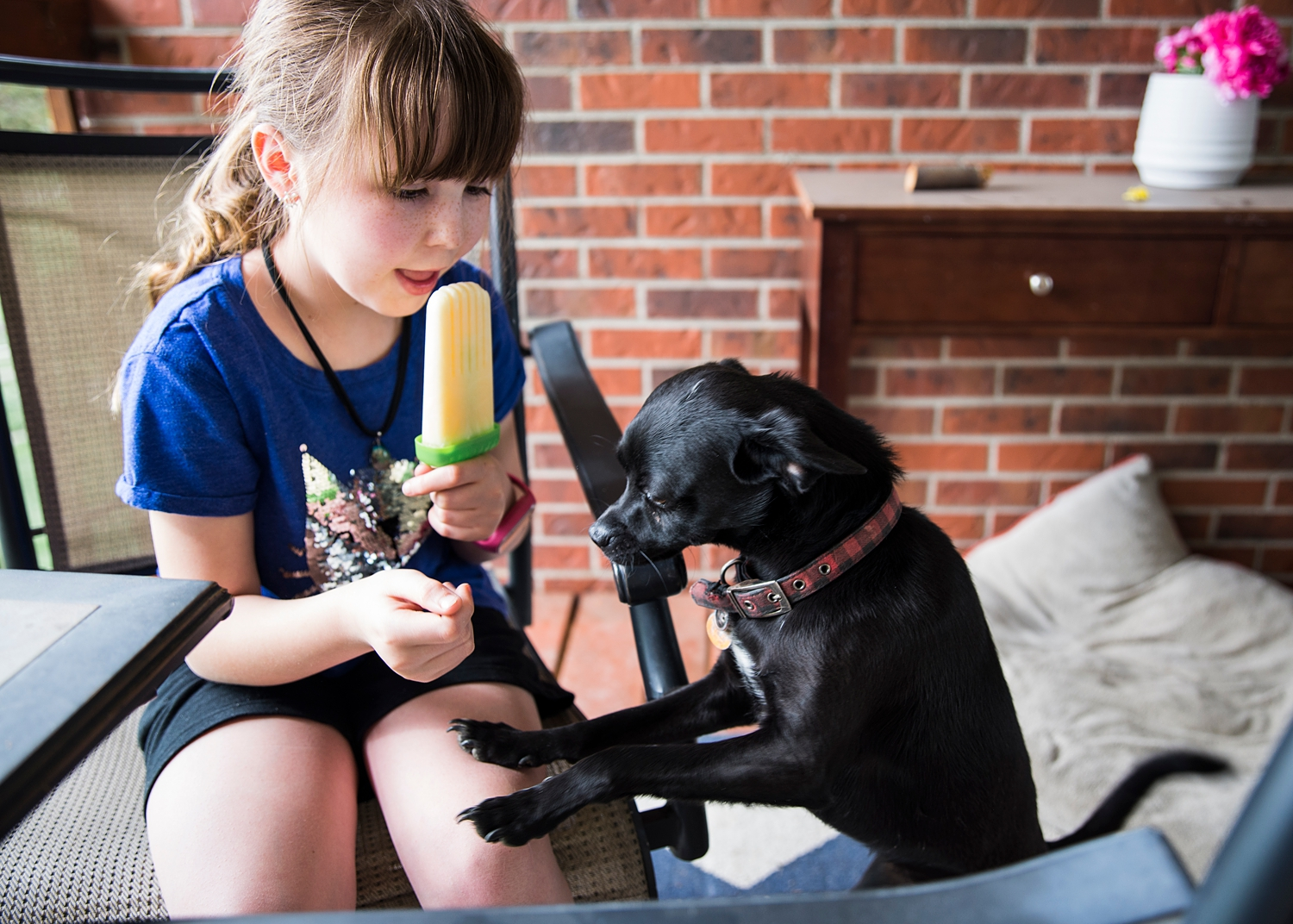Keeping the dogs away from her homemade creamsicles is part of the job.  Why homeschooling is good is something we try to show in our Week in the Life of an Unschooler series :)
