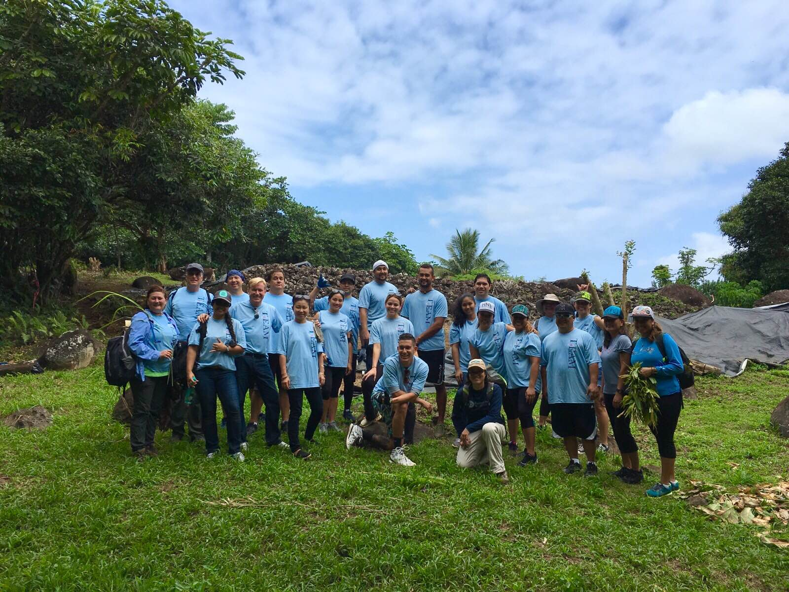 Hawaiian Airlines Team Kokua volunteering at Maunawila Heiau, O'ahu.