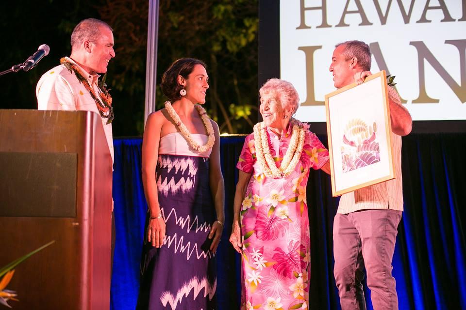 Jessica Welch, Executive Director of the Manoa Heritage Center and Mary Cooke accept the 2017 Kahu o Ka Aina Award presented by HILT Board Chairman Matt Beall at HILT's 2017 Malama Aina Kakou event at Lanikuhonua