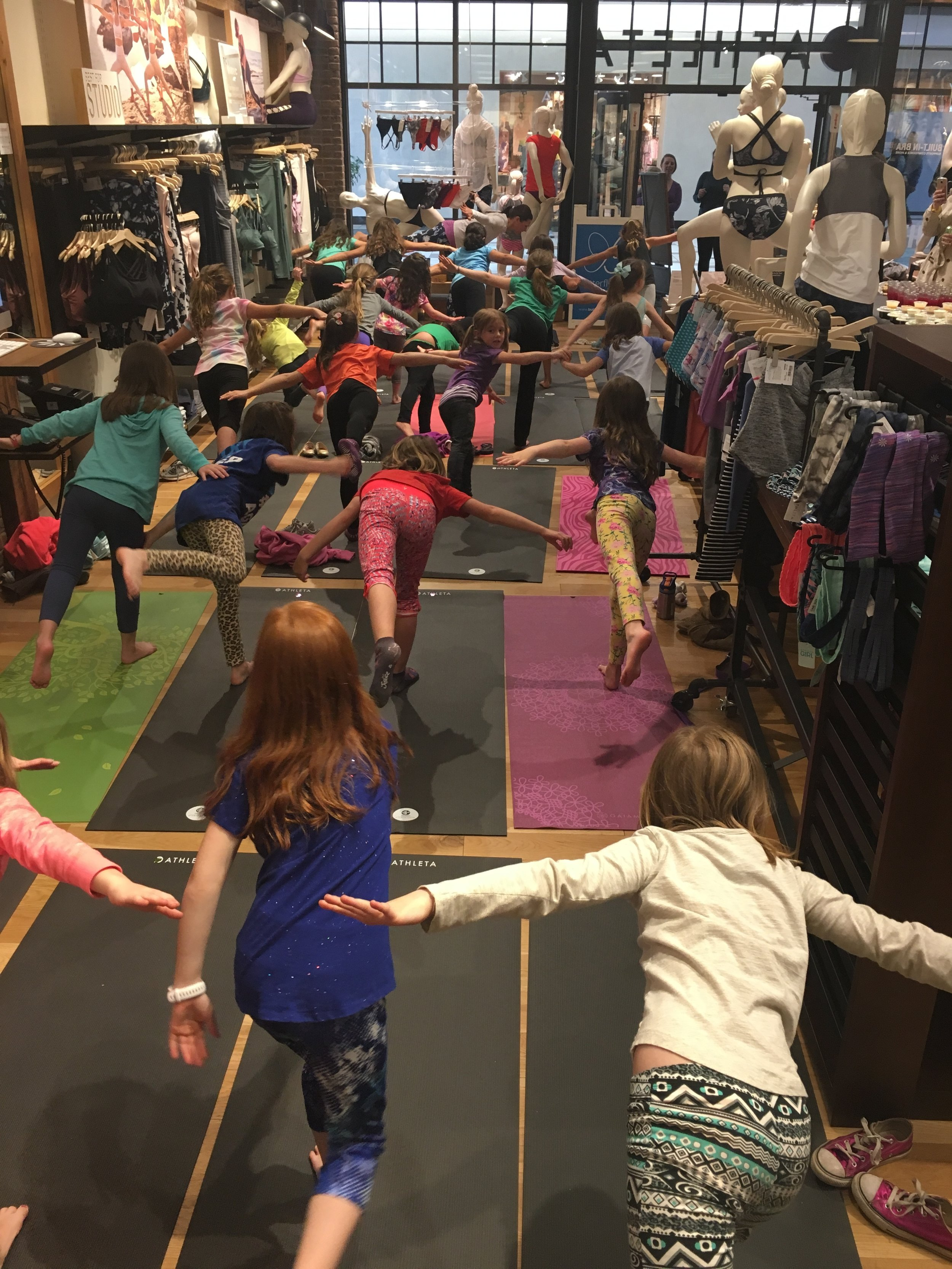Butterfly Kids Yoga celebrating the new Athleta Girl collection.A packed house!