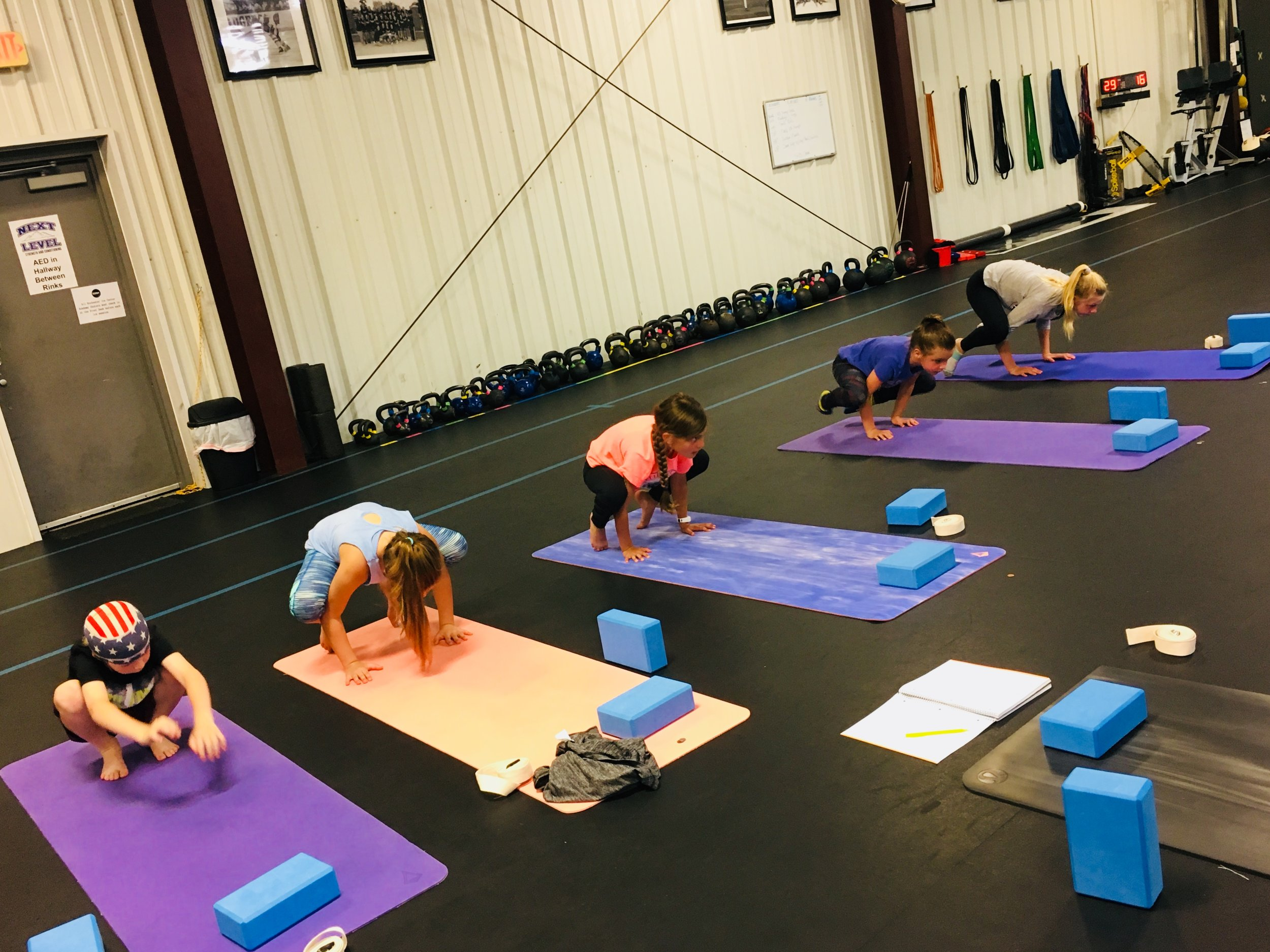 Balance and focus work during a Yoga for Athletes class. Super strong!