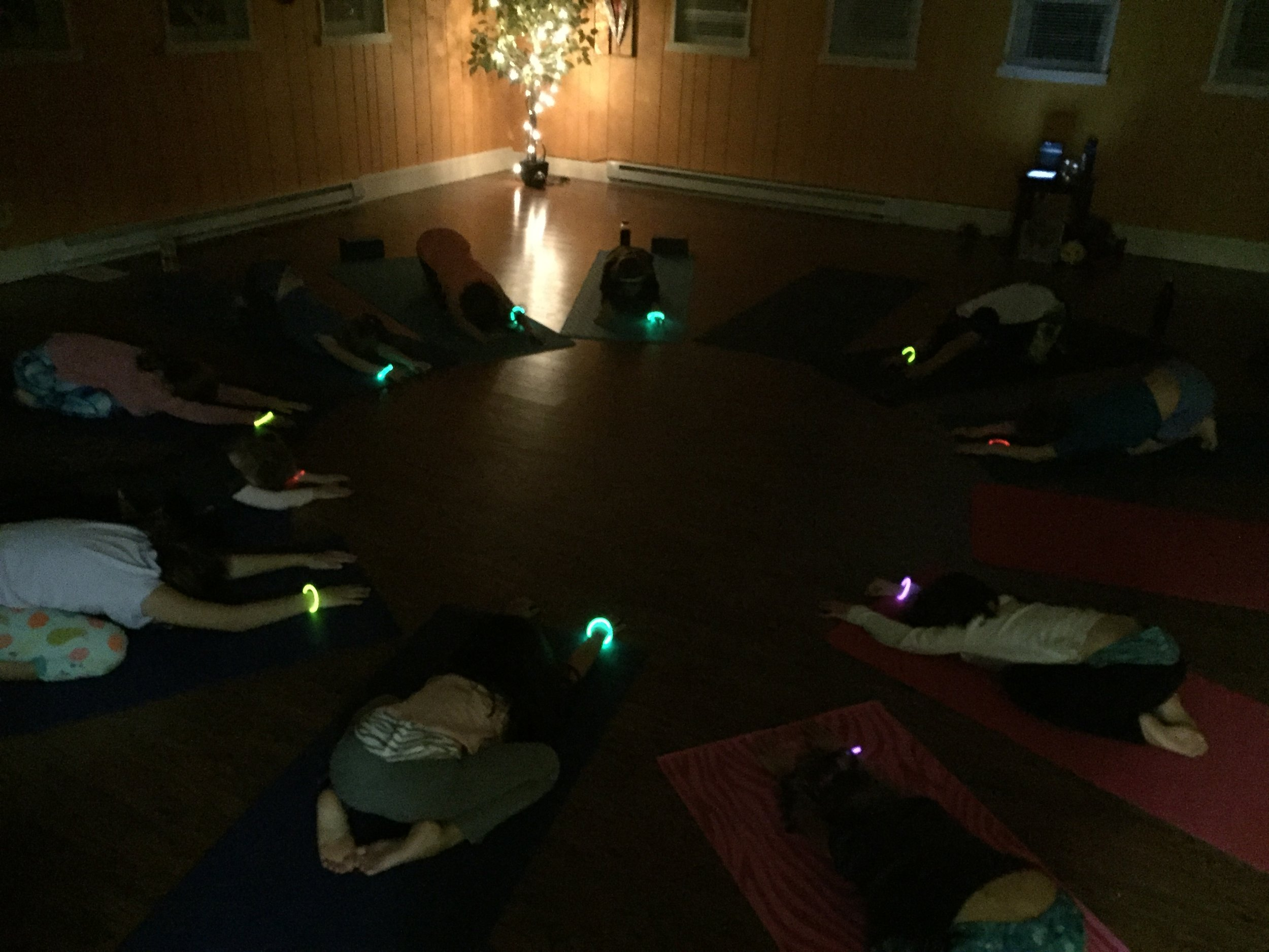 Stretching it out in child's pose after our glow-yoga dance party!