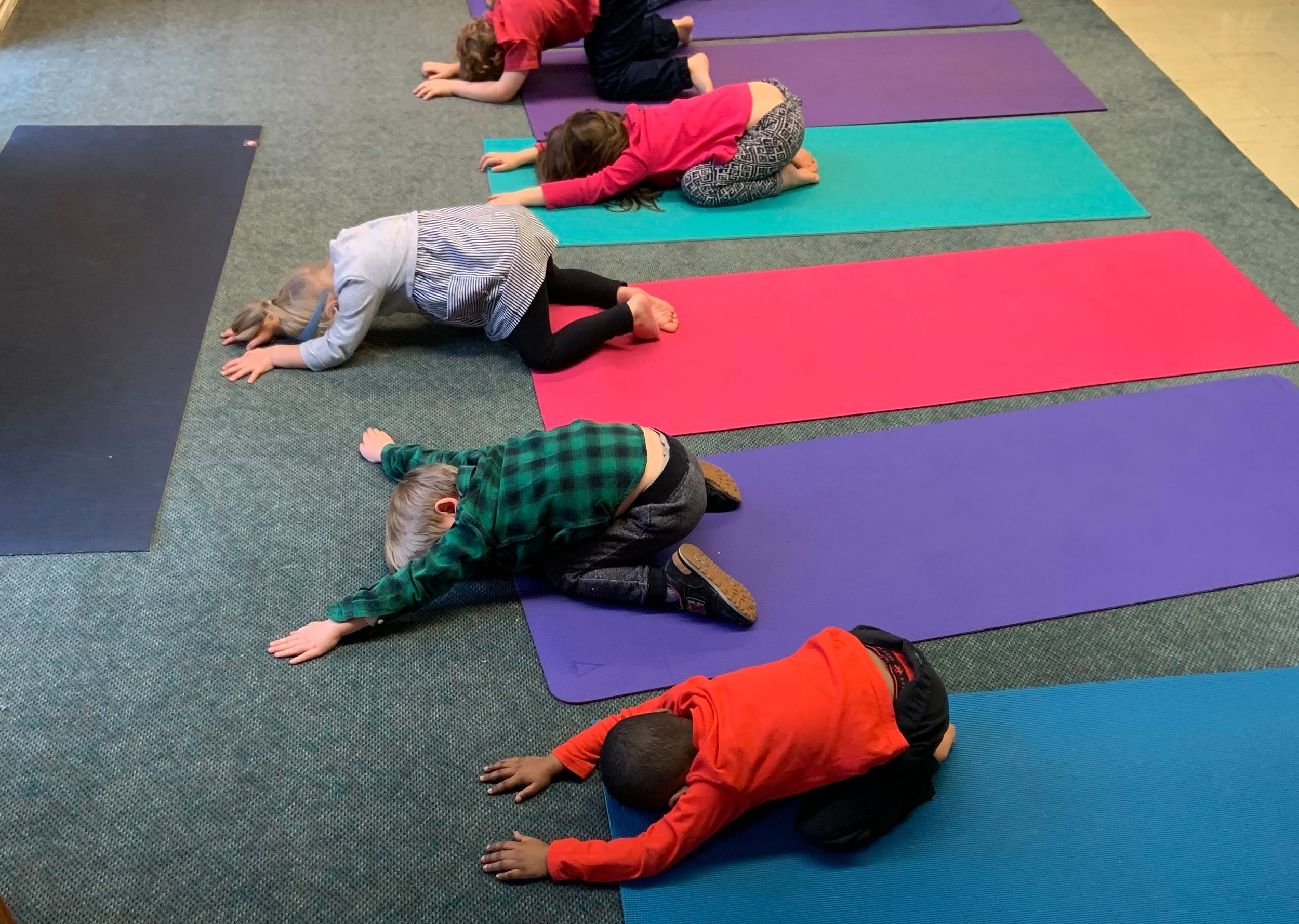 Yoga at preschool — even the littlest yogis love Child's Pose stretch!