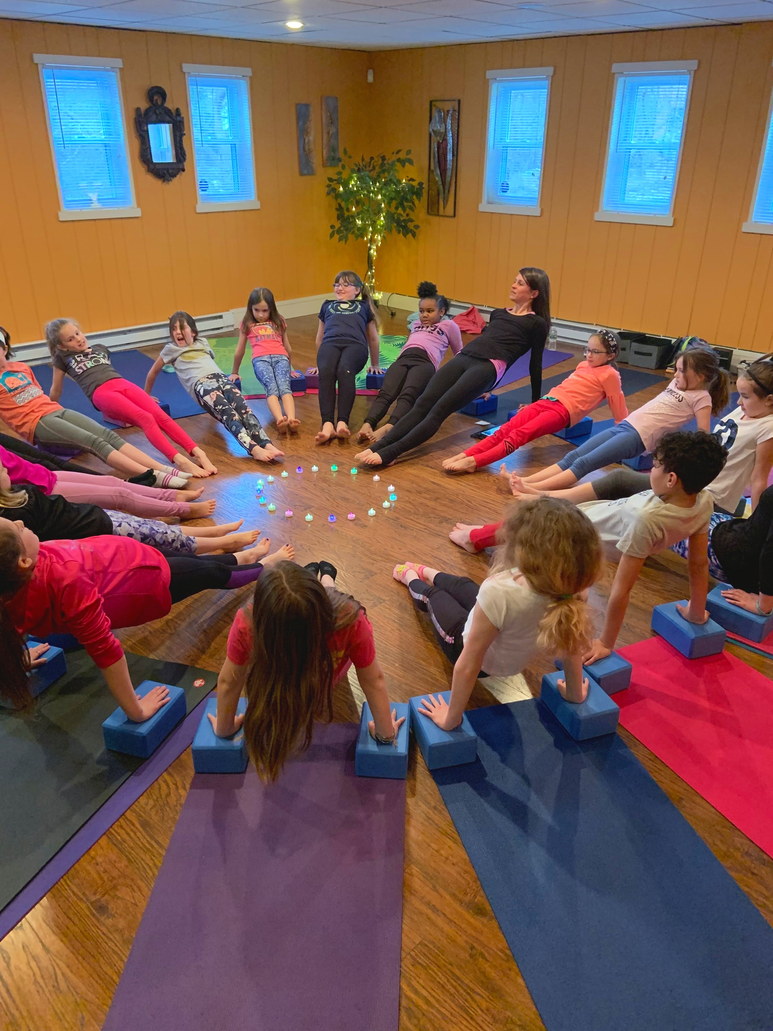 Tween Yoga + class . Incredibly strong and self-confident!