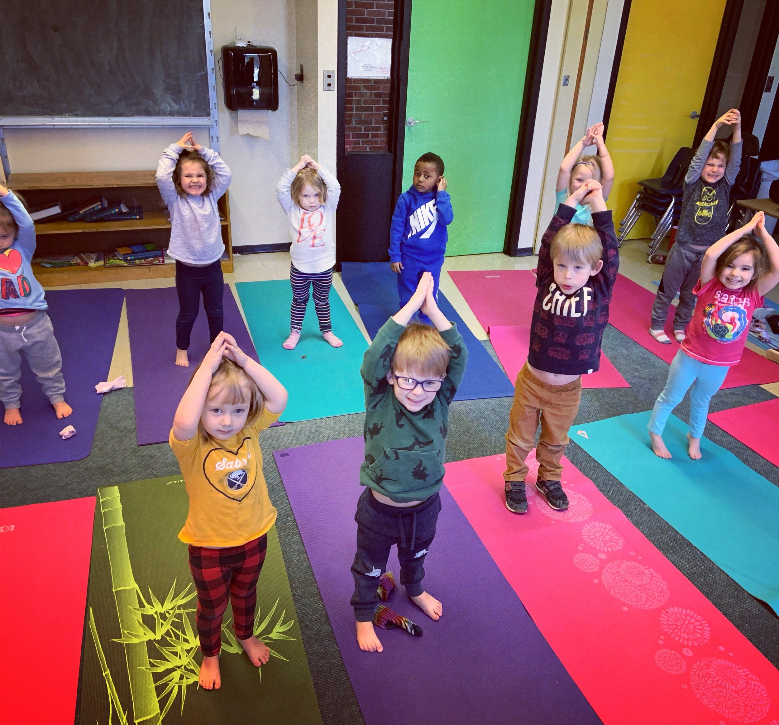 Little yogis with strong poses and big hearts!