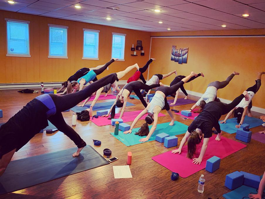 Yoga for Sports Teams — this team is building heat with incredible strength and focus.