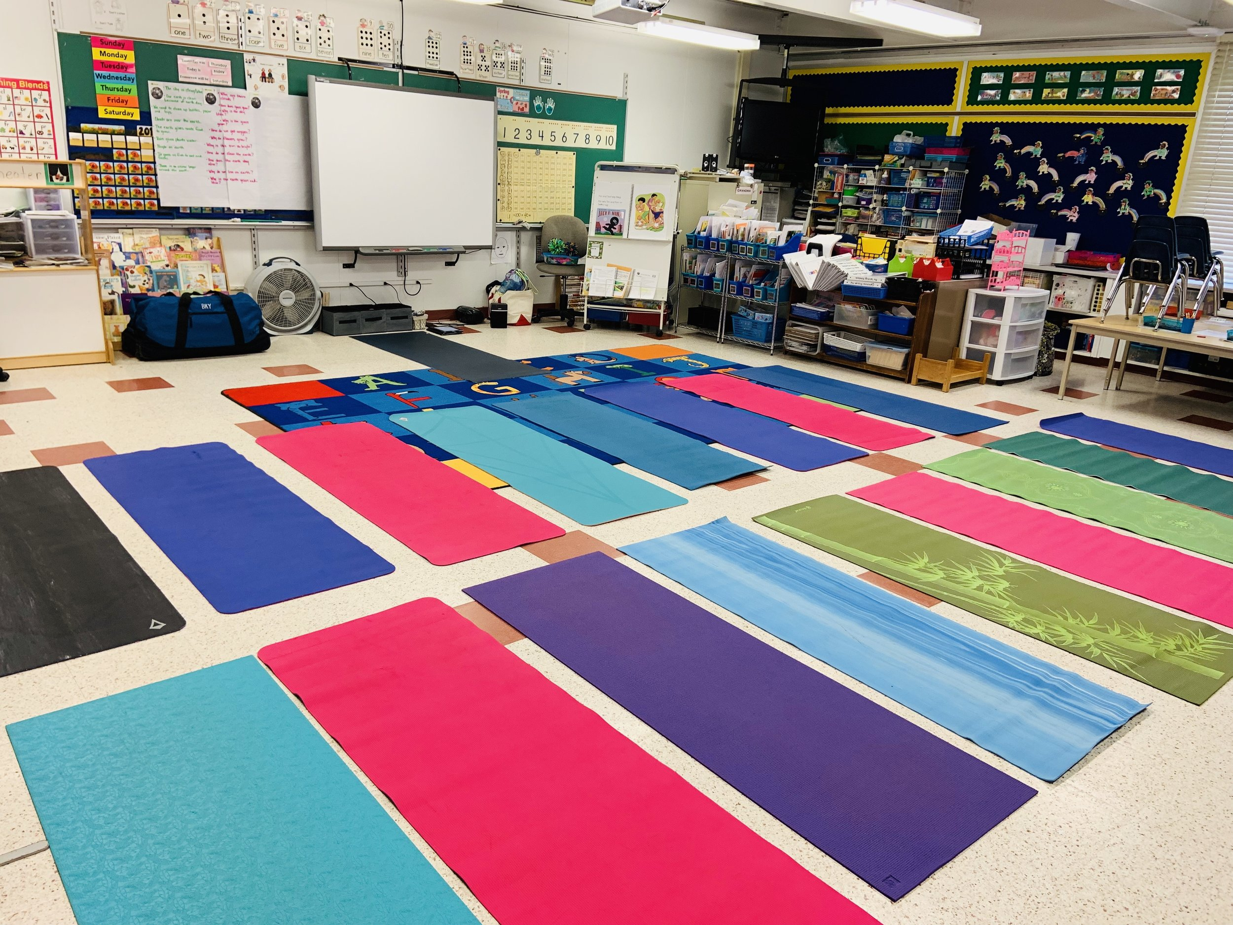 Rolling out our mats for Yoga at School — so beneficial for students!